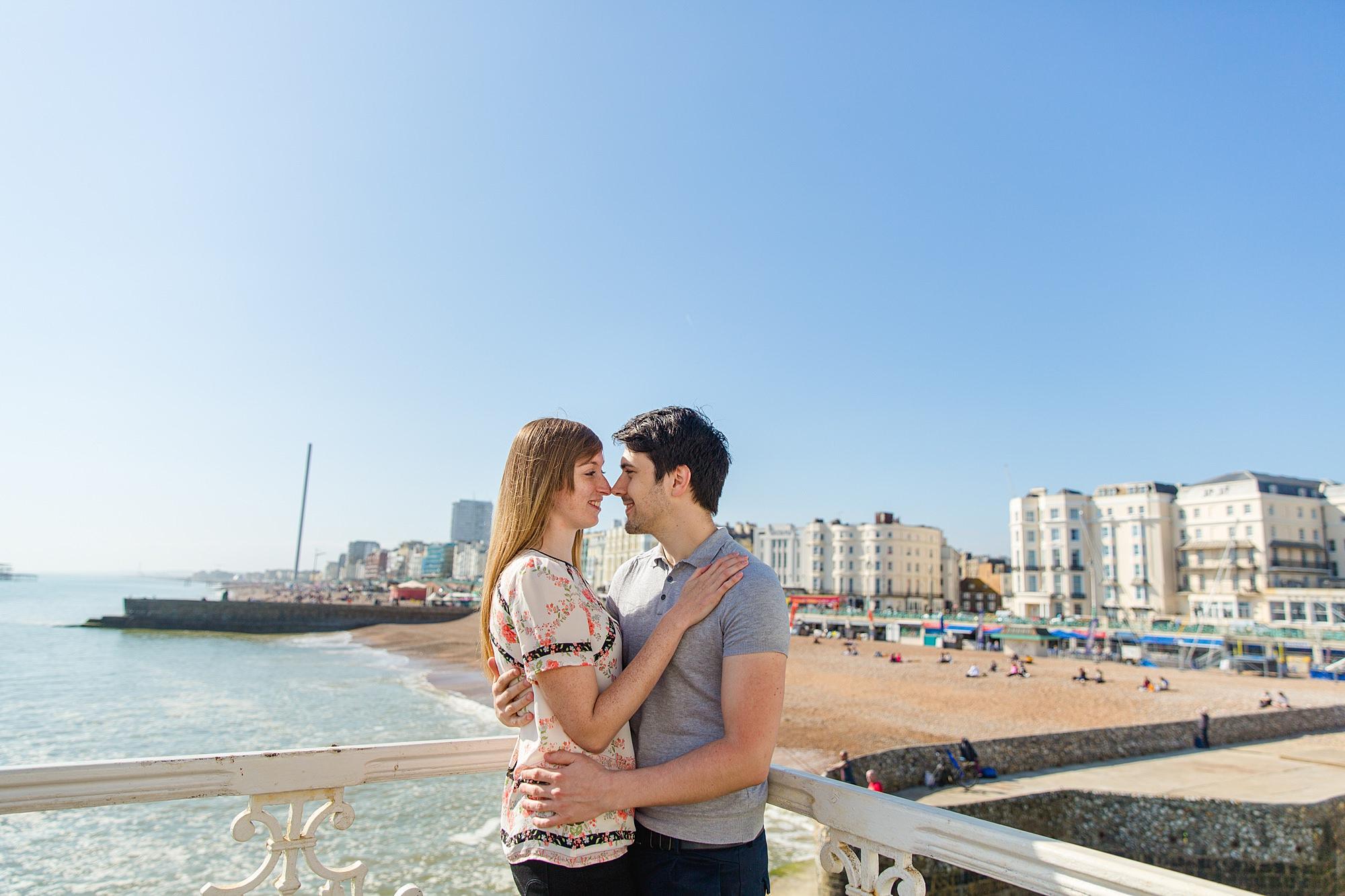 Fun Brighton engagement shoot couple kiss on brighton pier