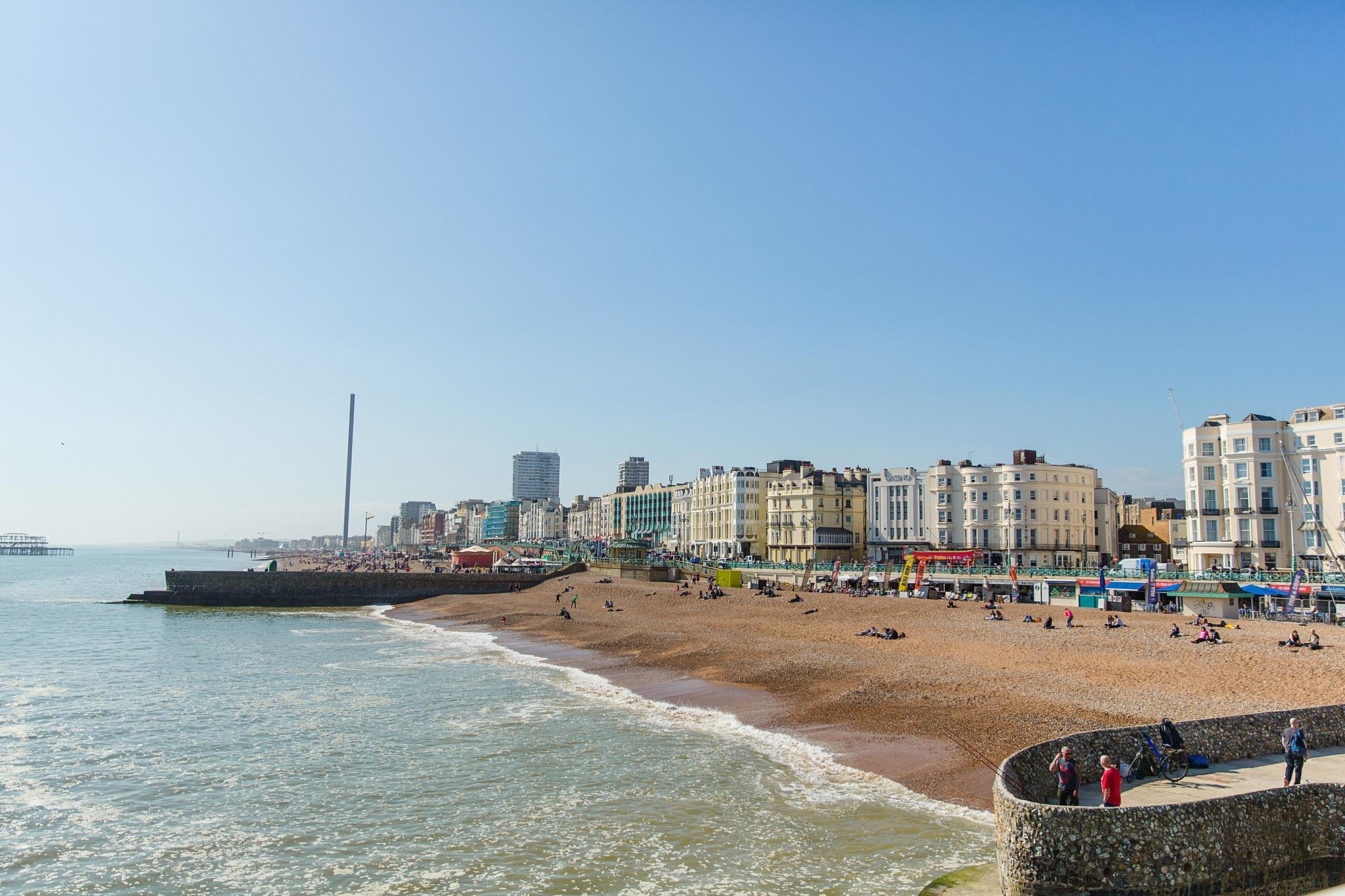 Fun Brighton engagement shoot view if brighton beach from pier
