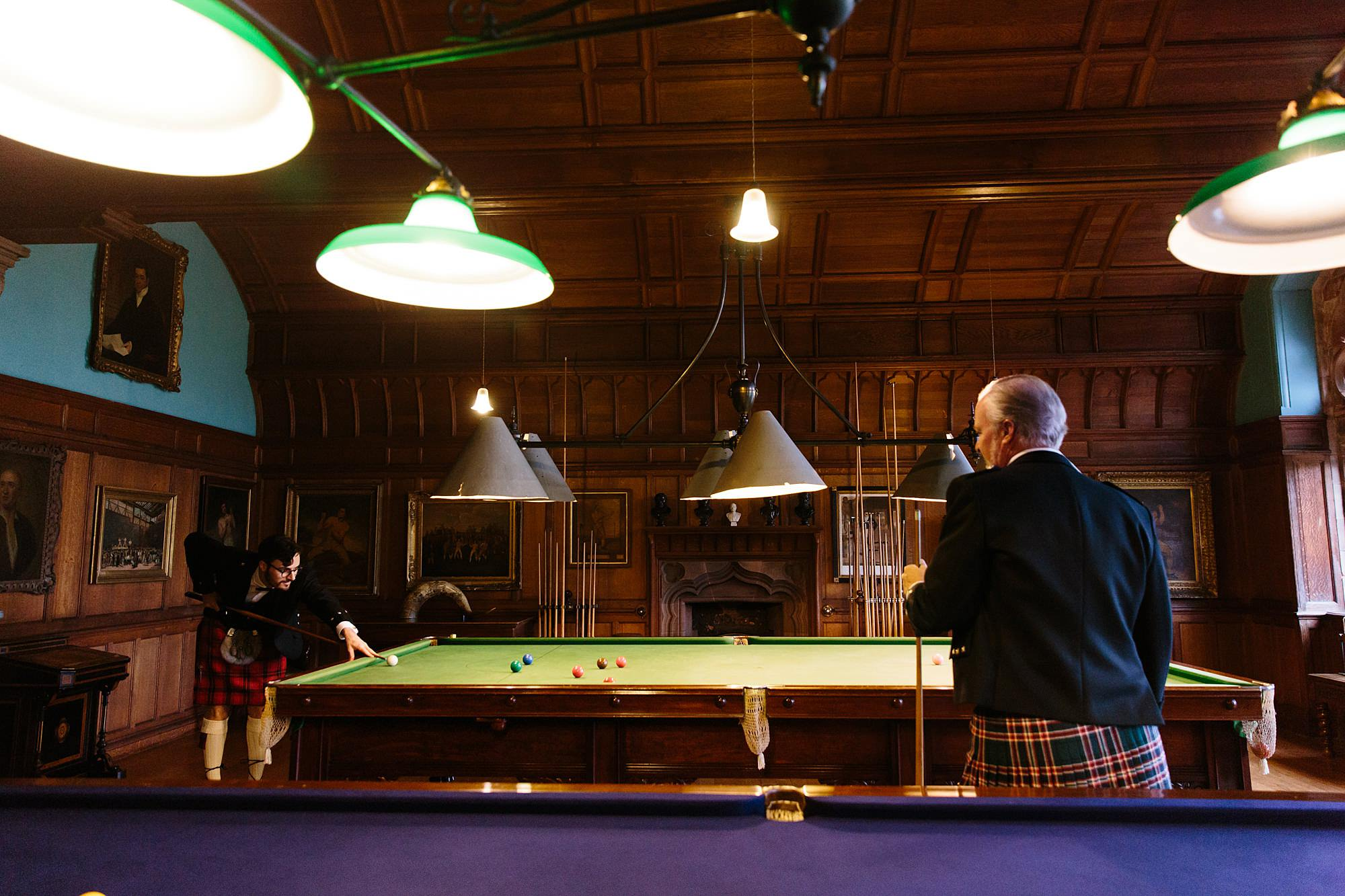 intimate wedding scotland groom and father playing billiards