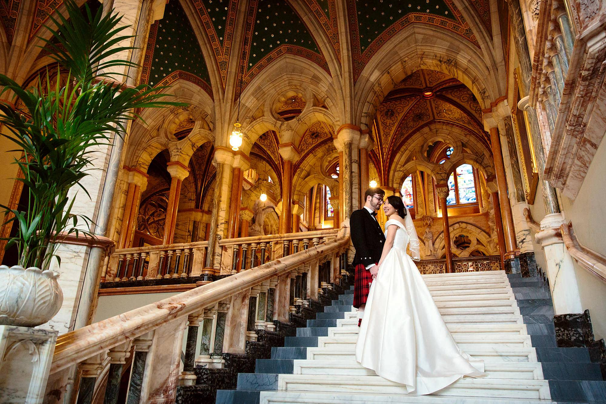 intimate wedding scotland groom and bride on stairs at mount stuart