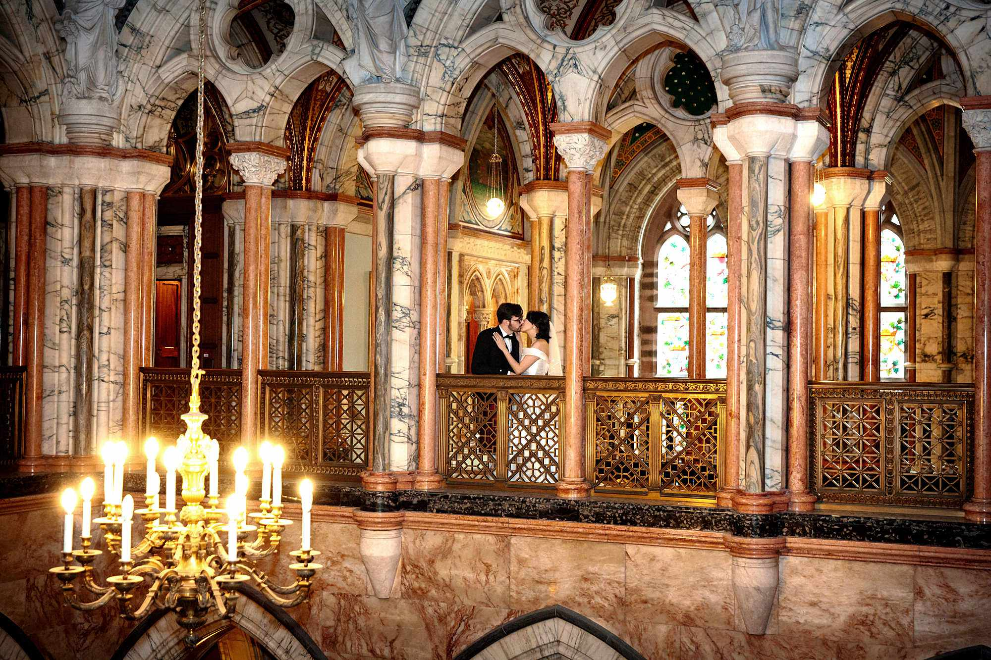 intimate wedding scotland bride and groom on balcony at mount stuart