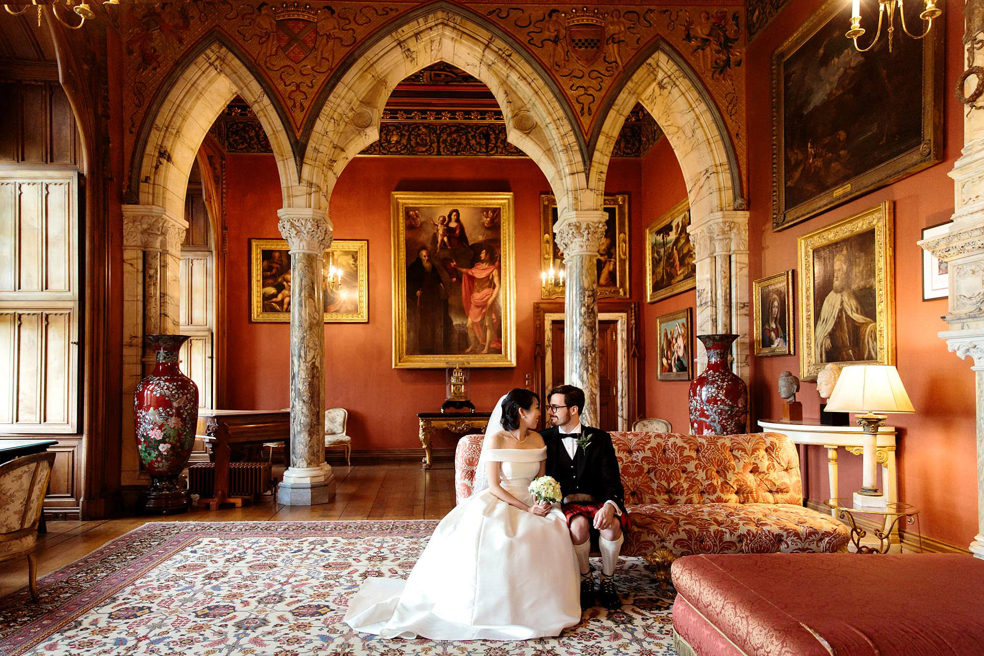intimate wedding scotland bride and groom in red room at mount stuart