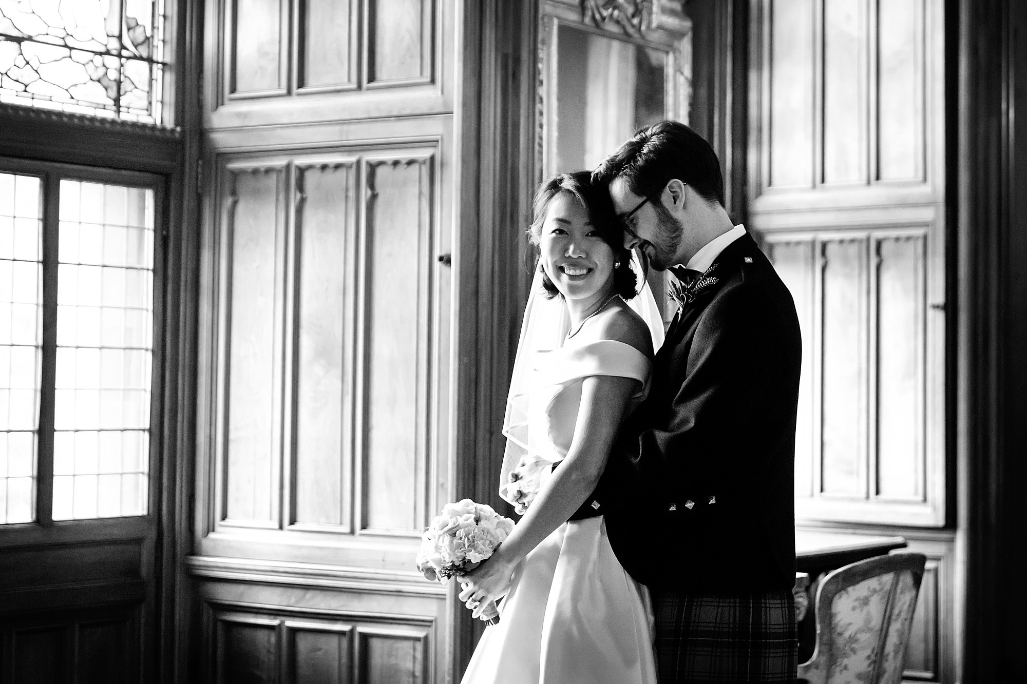 intimate wedding scotland bride and groom by a window at mount stuart