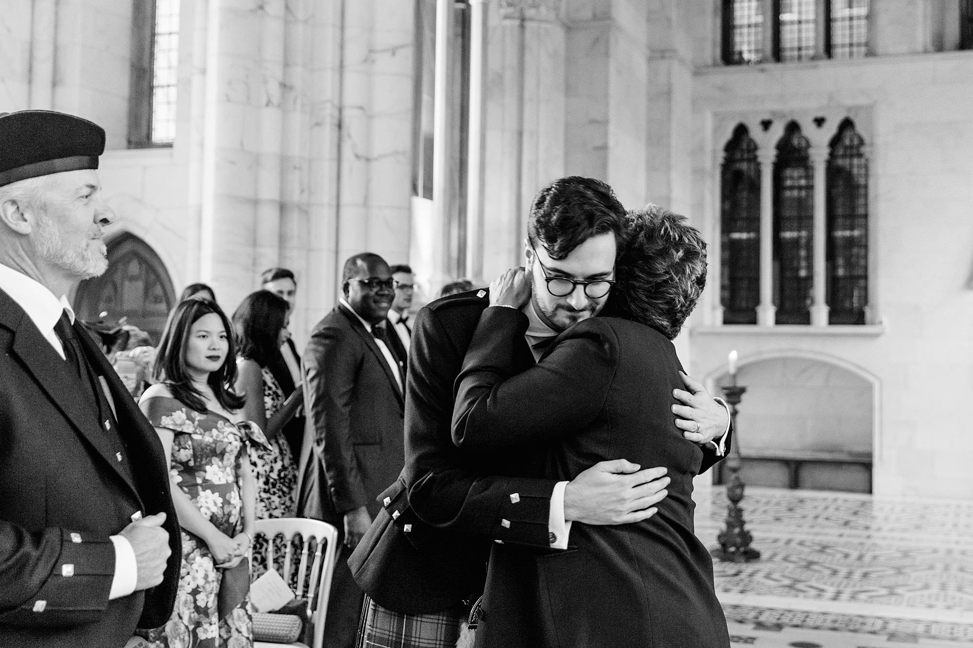 intimate wedding scotland portrait of groom hugging mother