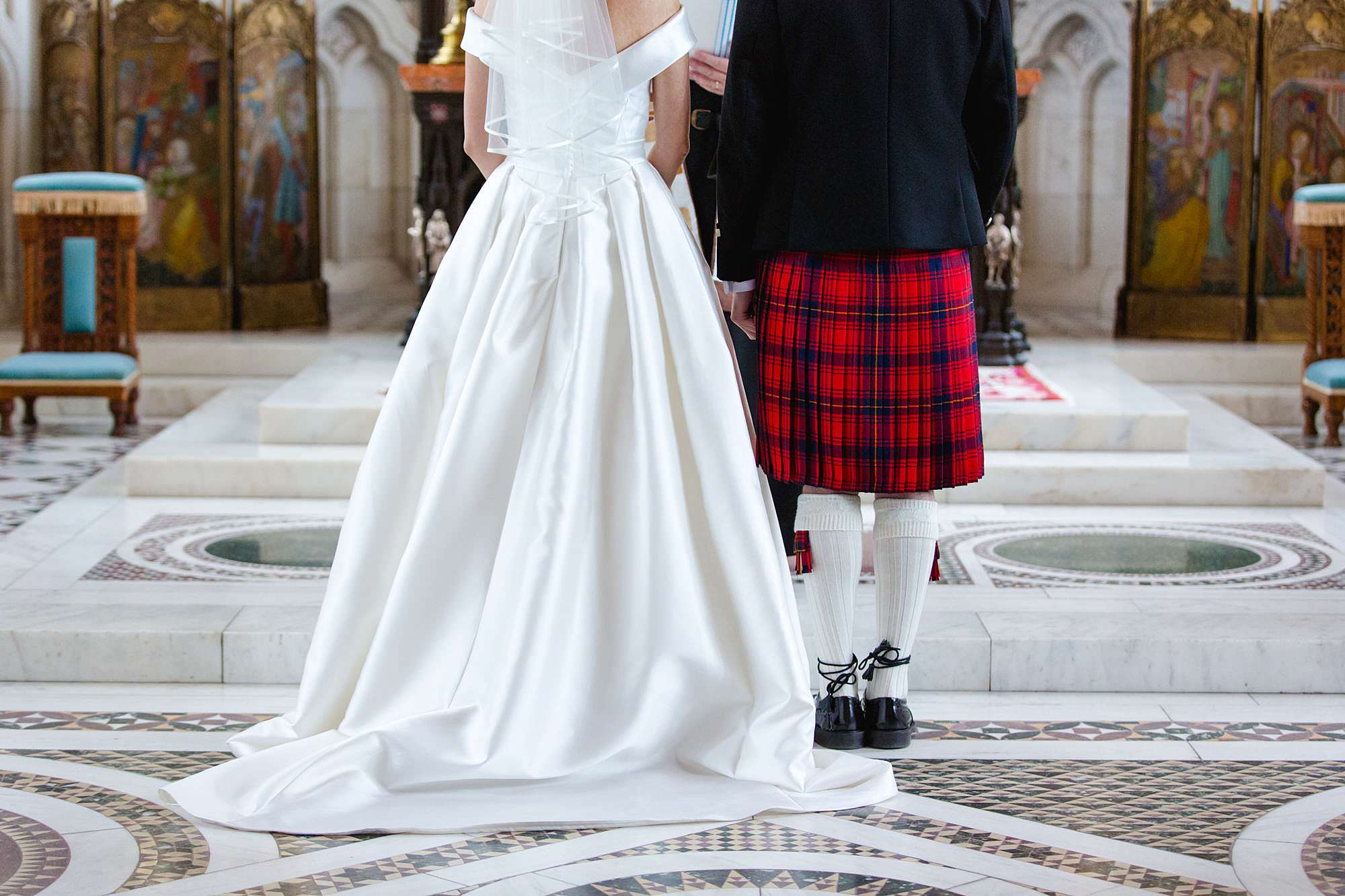 intimate wedding scotland close up detail of groom's kilt and bride's dress
