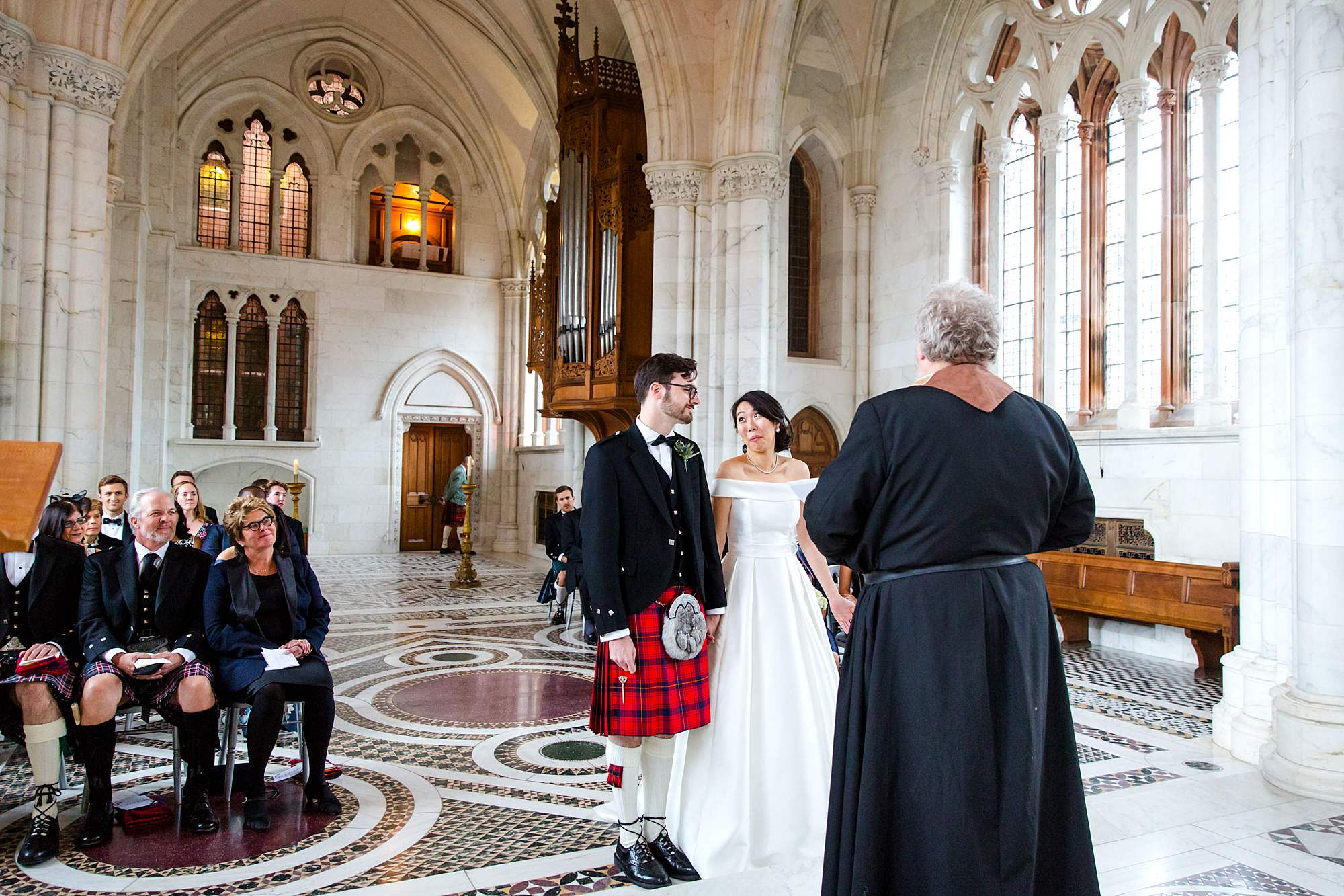 intimate wedding scotland bride and groom laughing during ceremony