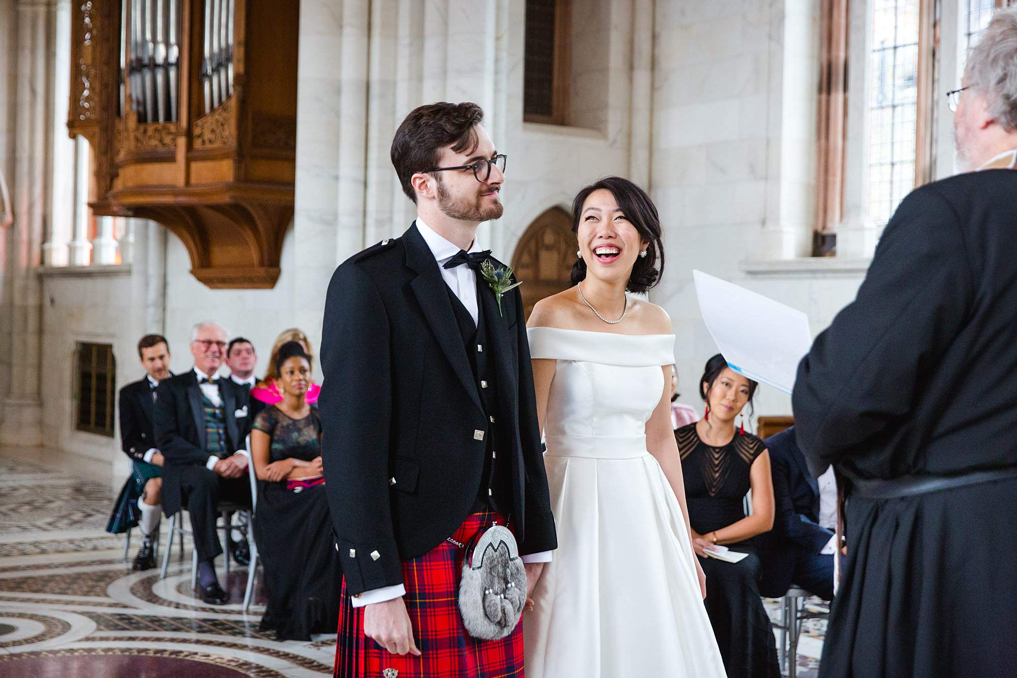 intimate wedding scotland from and bride laugh during ceremony