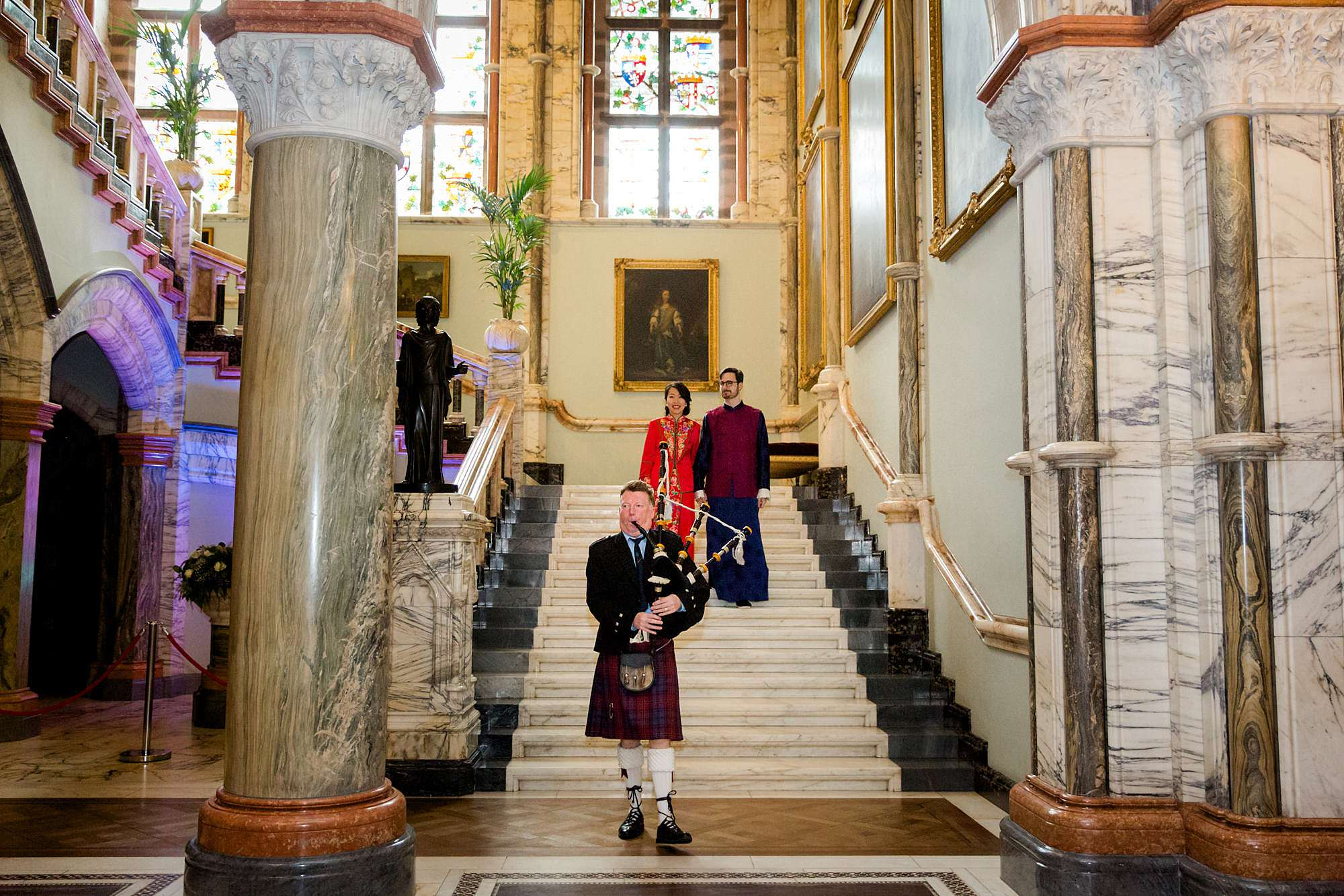 intimate wedding scotland bagpipes leading bride and groom