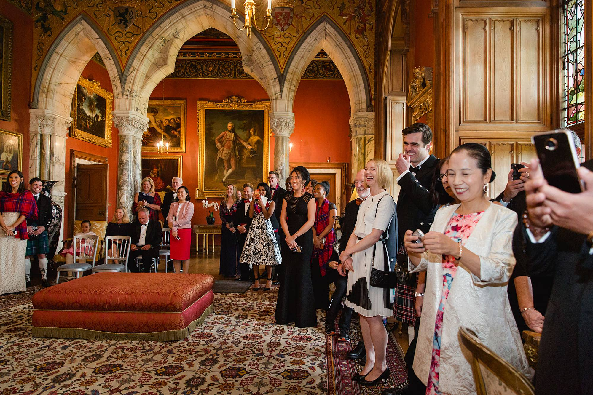 intimate wedding scotland guests watching chinese tea ceremony