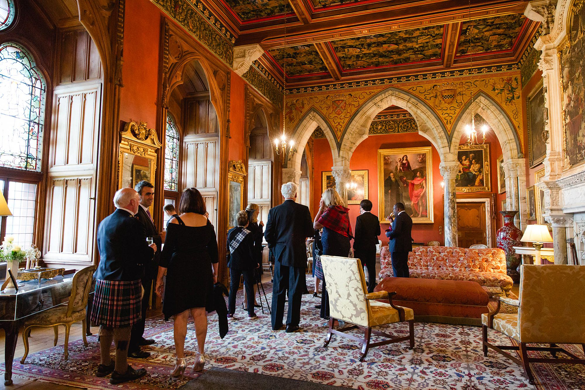 intimate wedding scotland drinks reception in red room at mount stuart