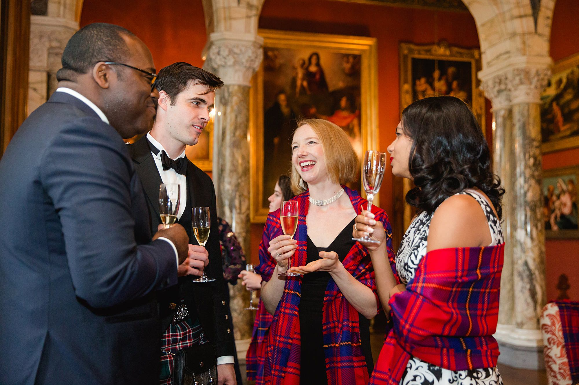 intimate wedding scotland guests laughing during drinks reception