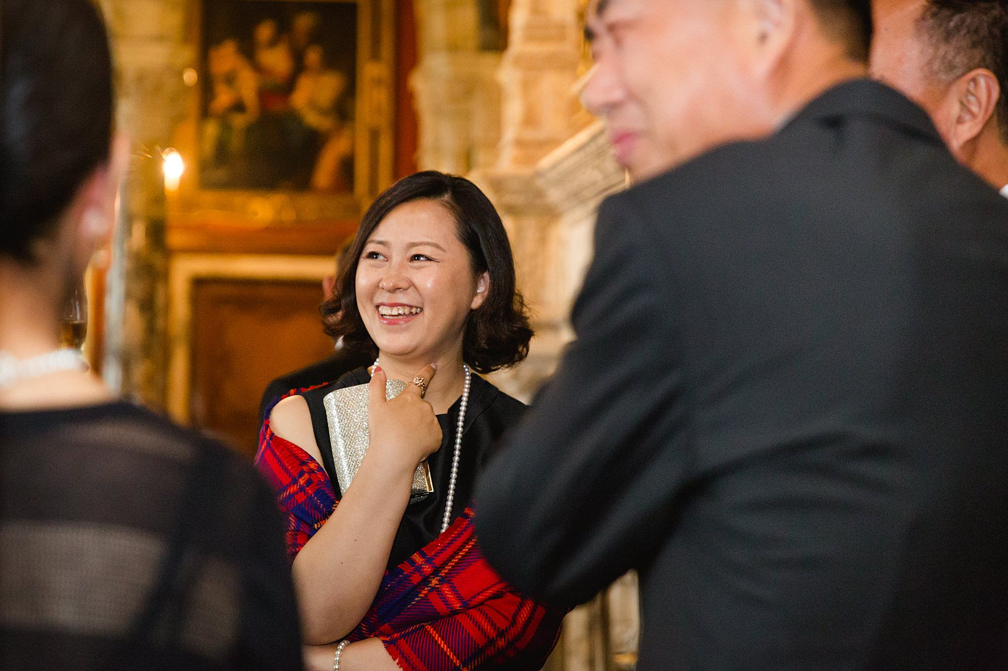 intimate wedding scotland guests laugh together