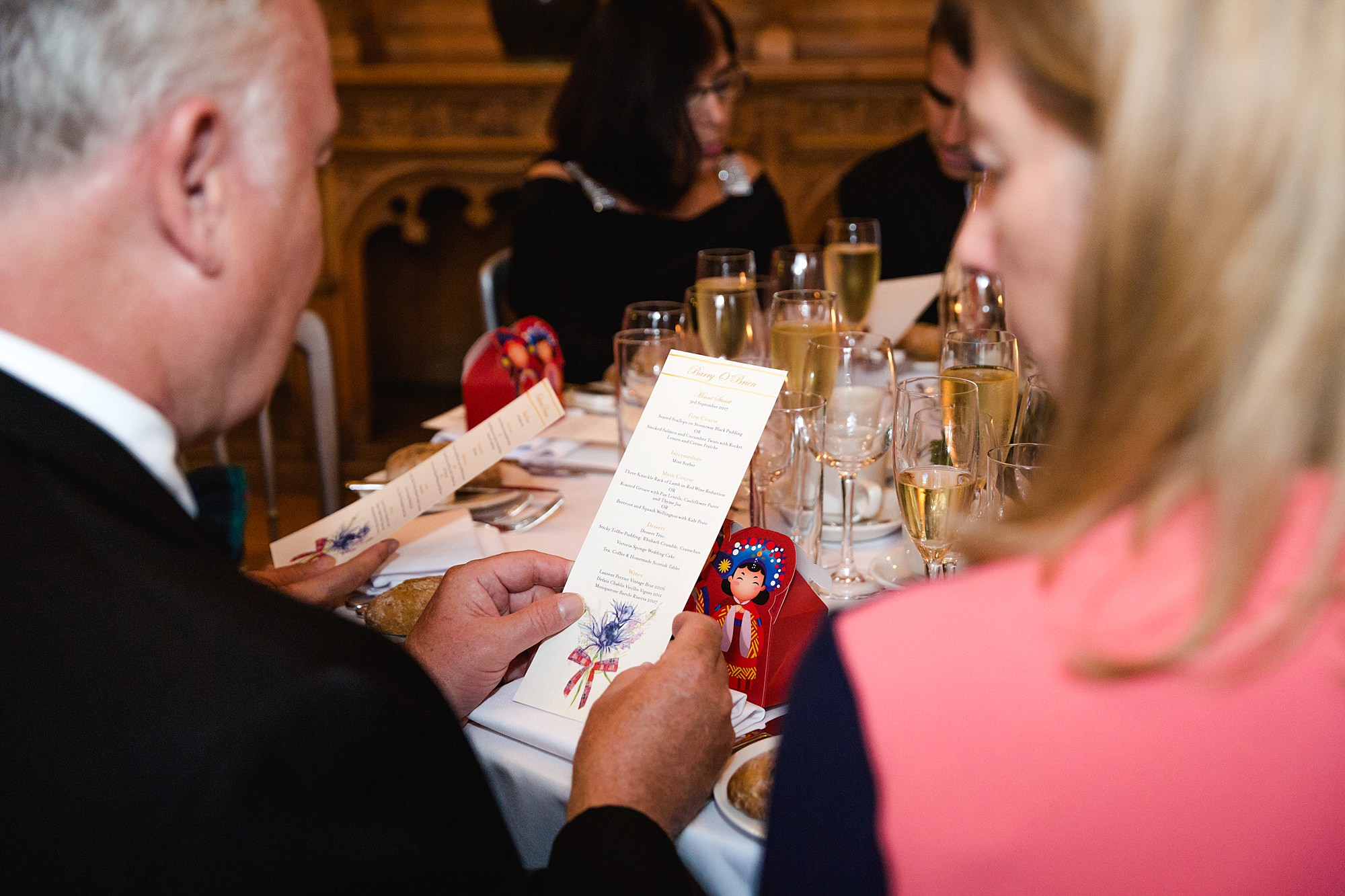 intimate wedding scotland guests looking at menu