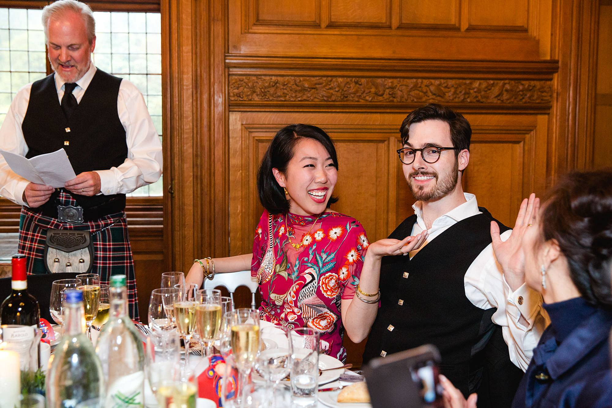 intimate wedding scotland bride and groom laugh at speech