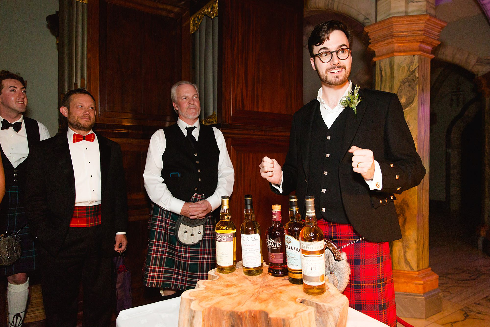 intimate wedding scotland groom gives whiskey tasting session