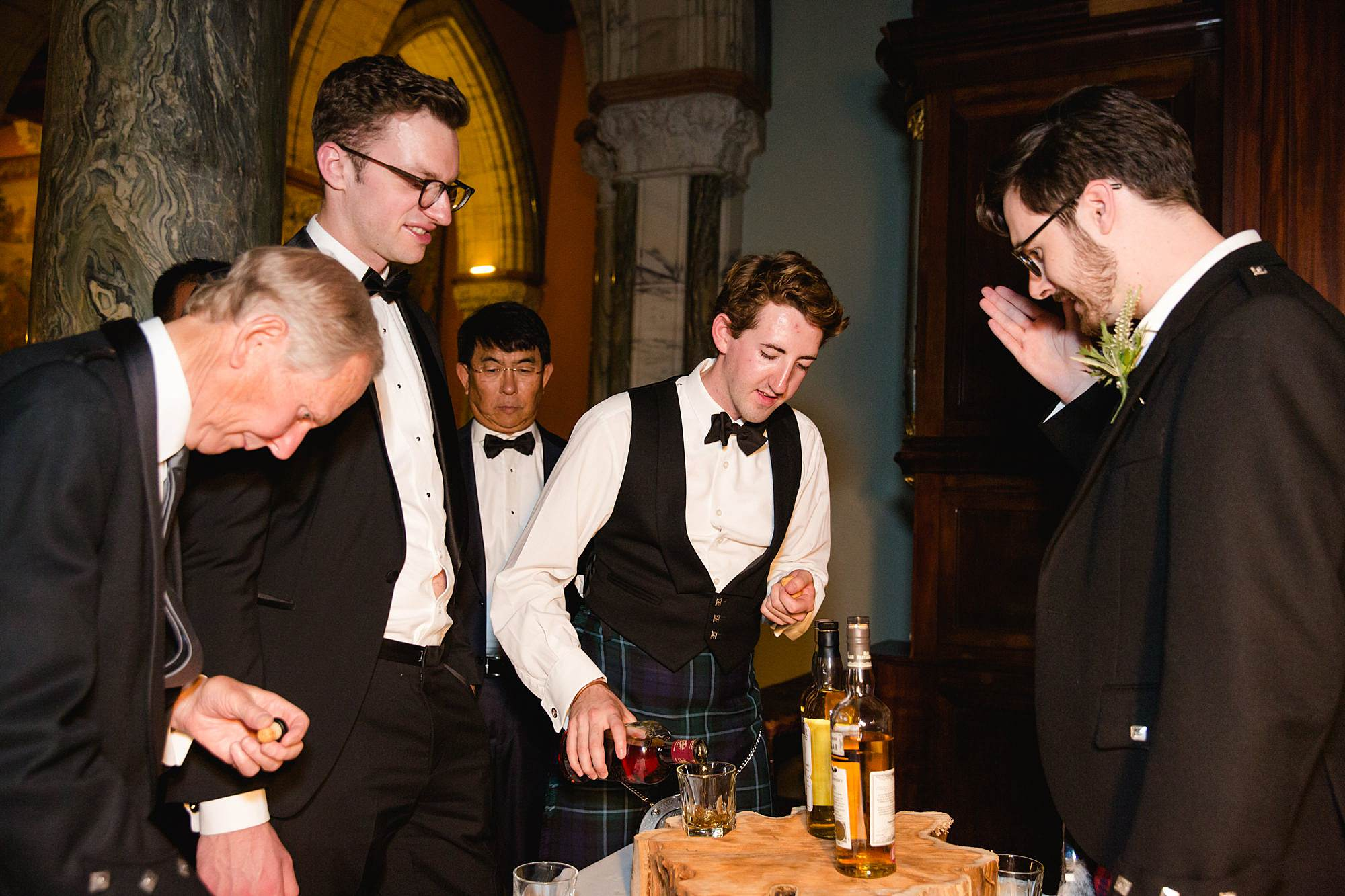 intimate wedding scotland guests tasting whiskey