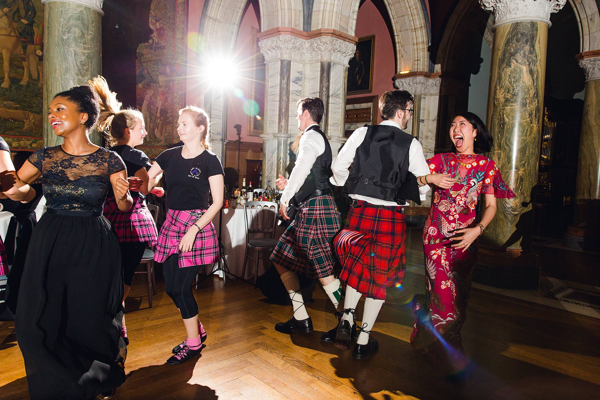 intimate wedding scotland guests laugh and dance together