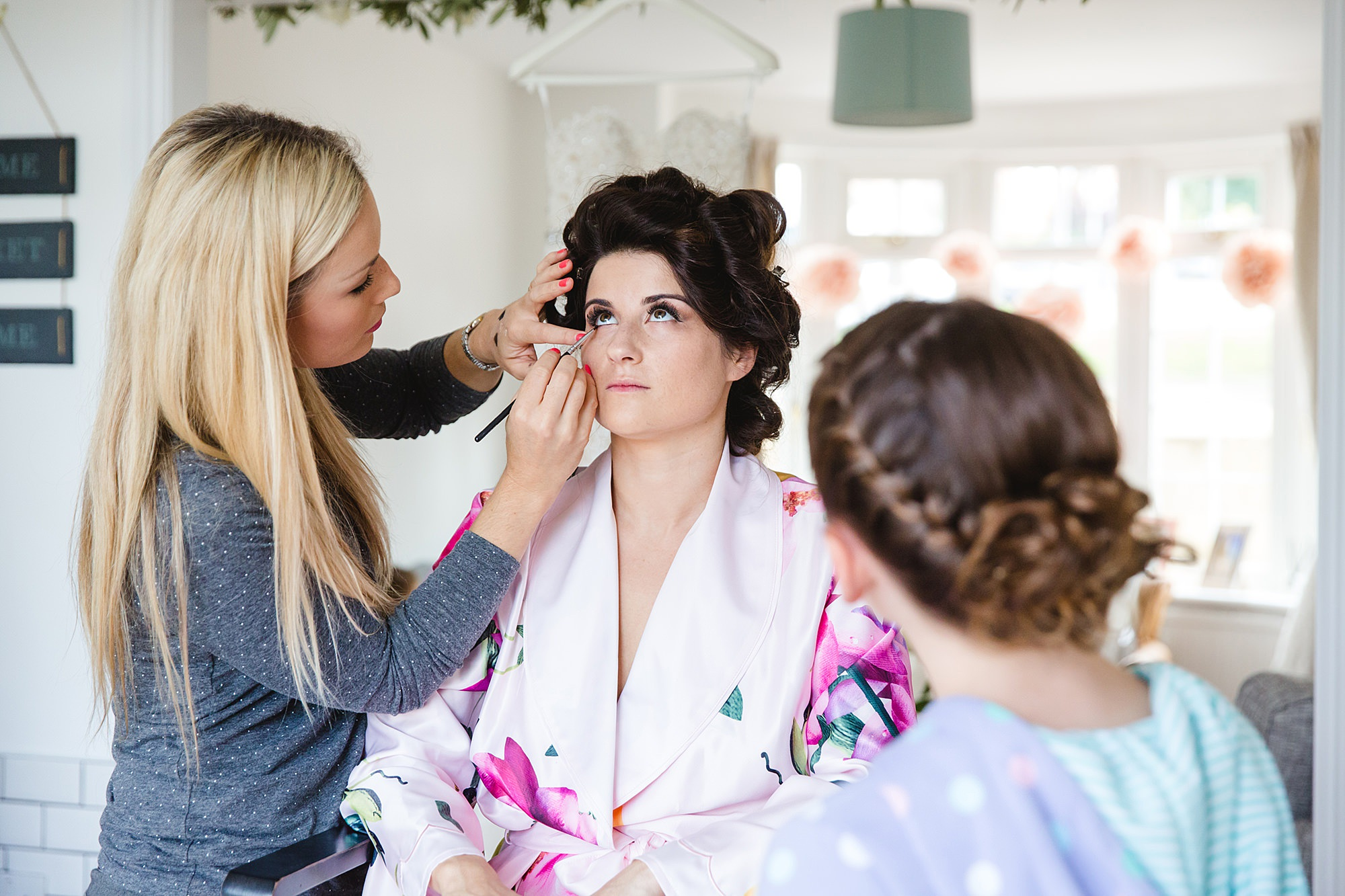 Lillibrooke Manor wedding flower girl watching bride have her makeup done