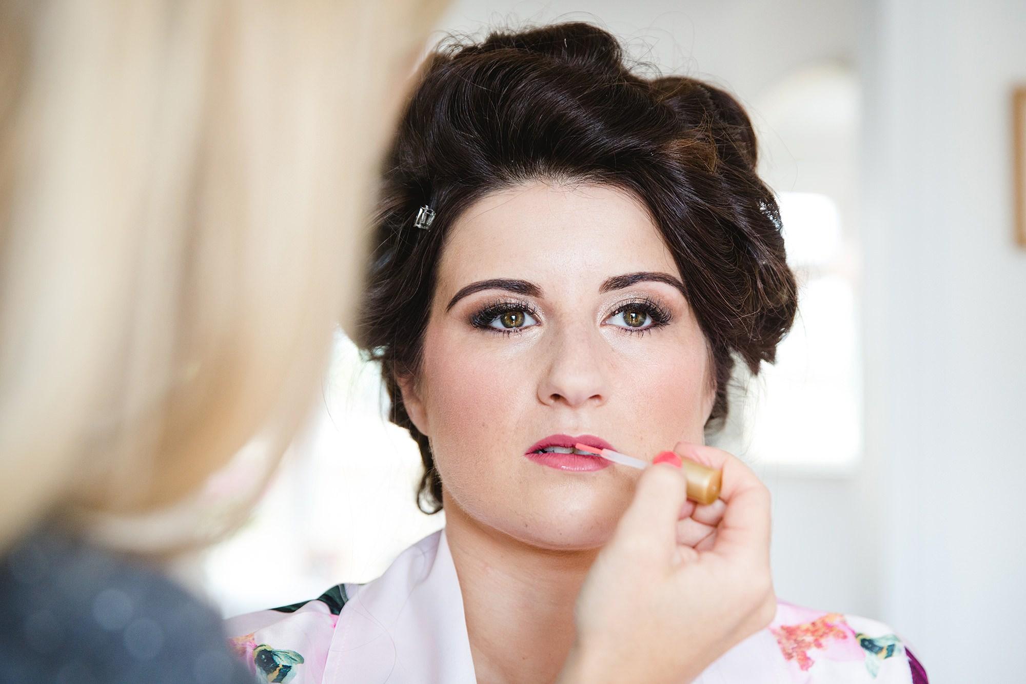 Lillibrooke Manor wedding bride has lipstick applied