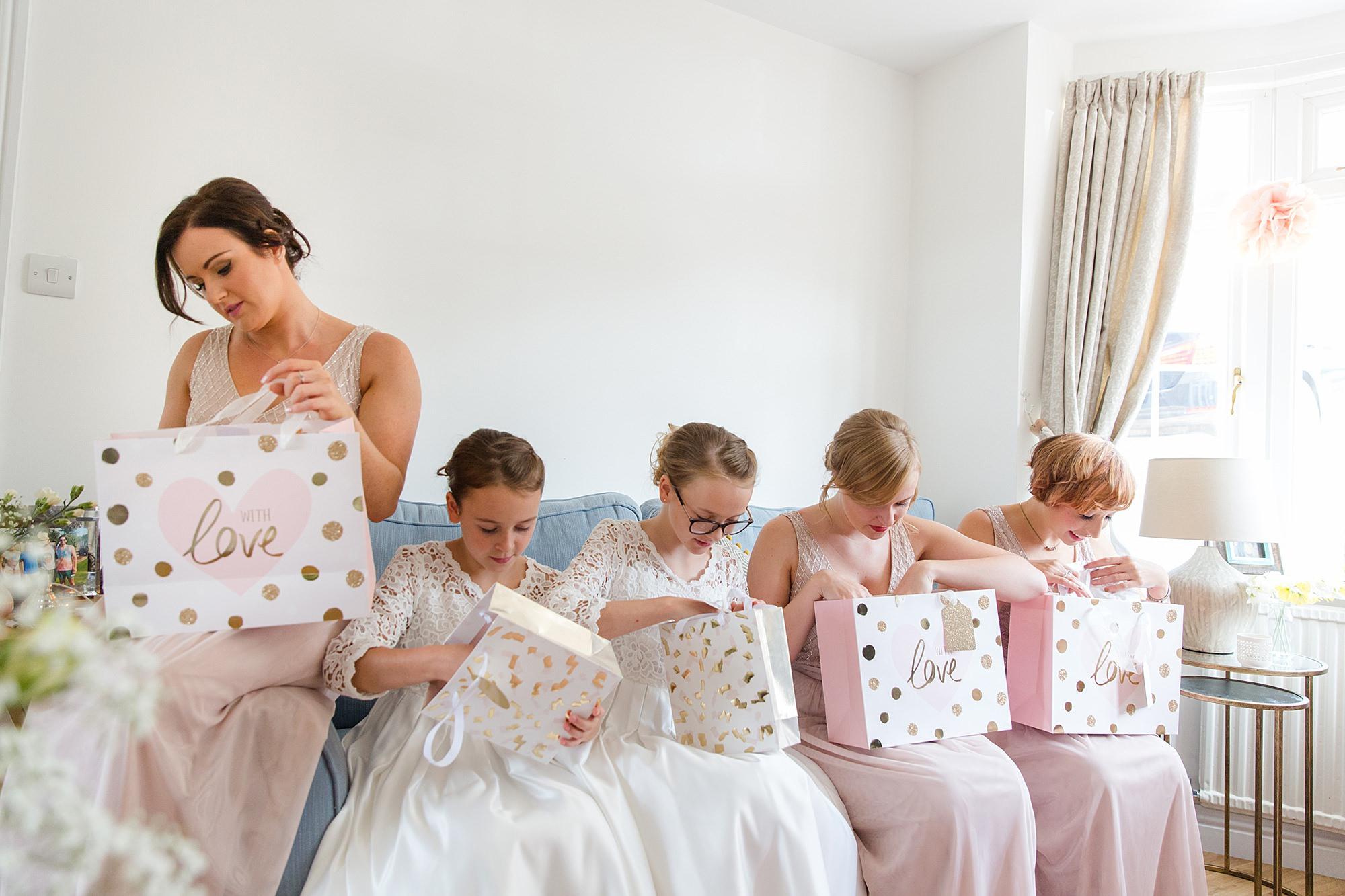 Lillibrooke Manor wedding bridesmaids opening gifts
