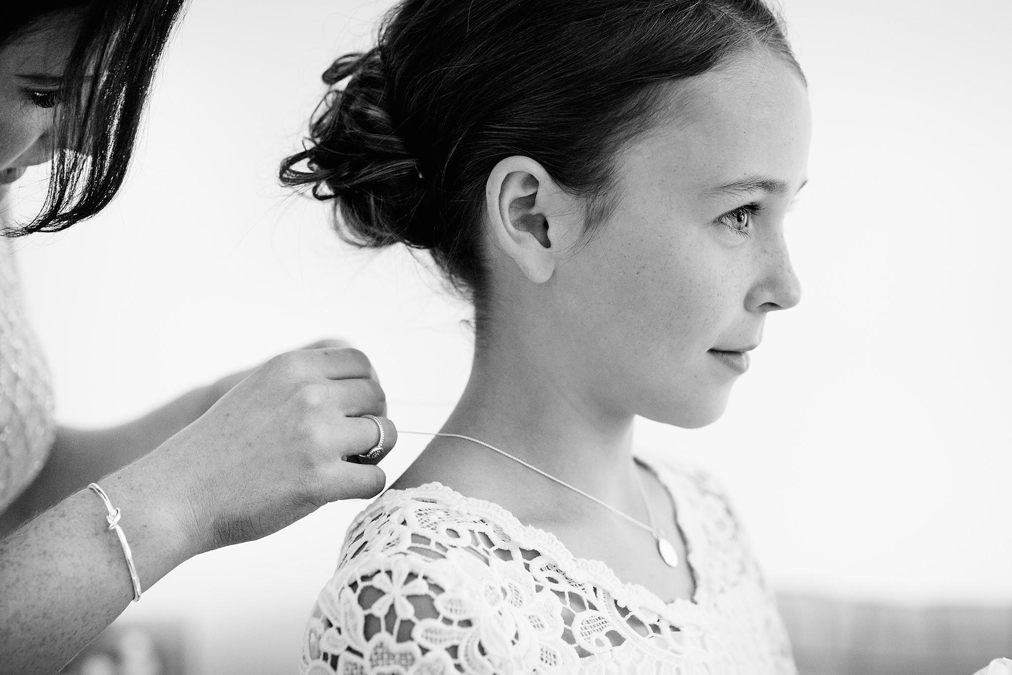 Lillibrooke Manor wedding bridesmaid having necklace put on
