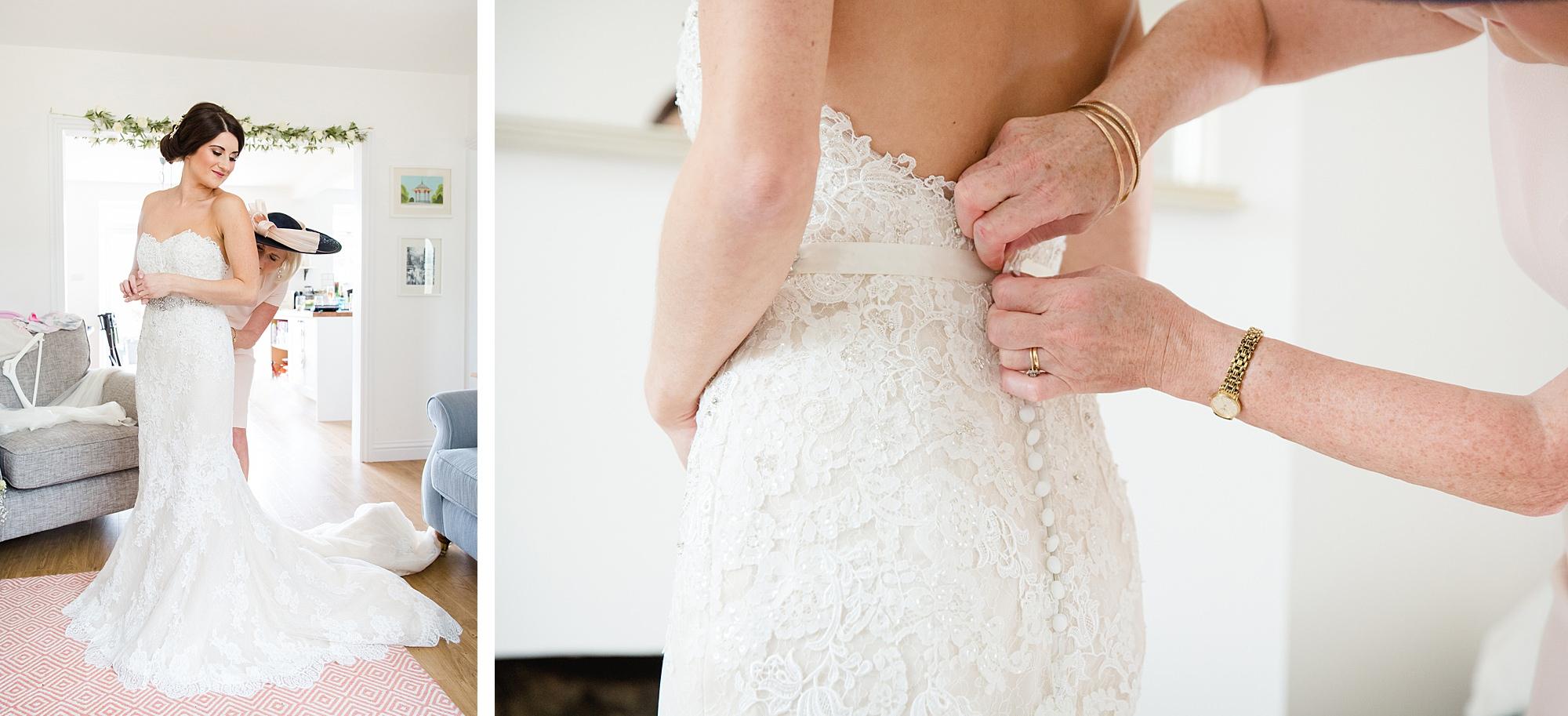 Lillibrooke Manor wedding bride puts on her dress