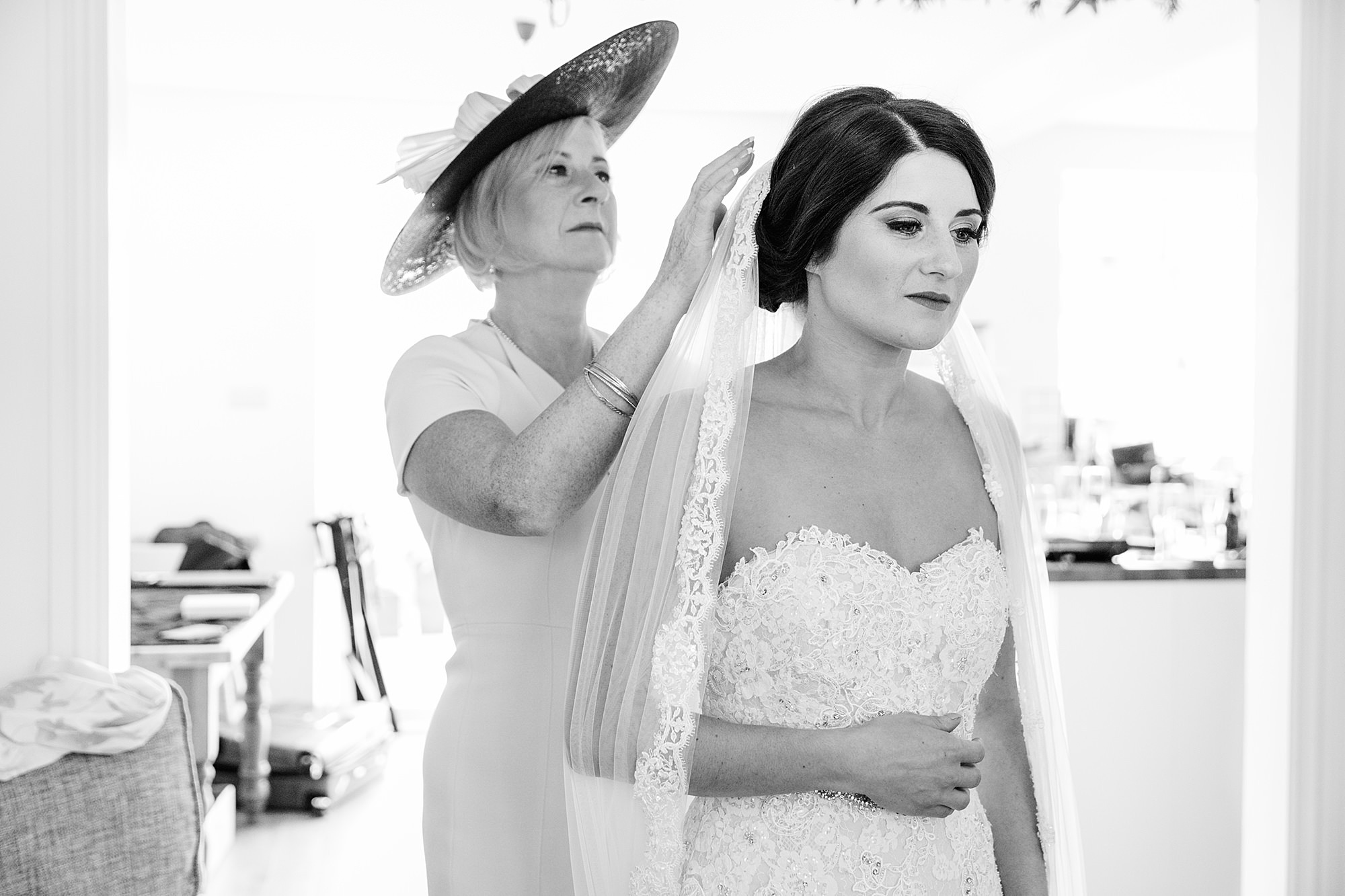 Lillibrooke Manor wedding mother of bride puts on bride's veil