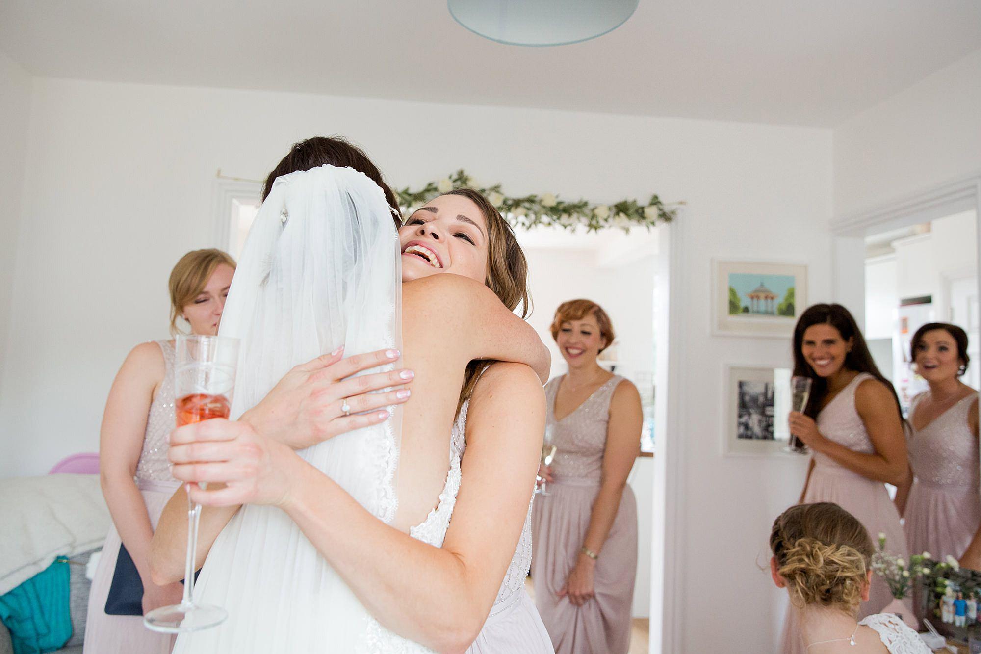 Lillibrooke Manor wedding bridesmaid hugs bride