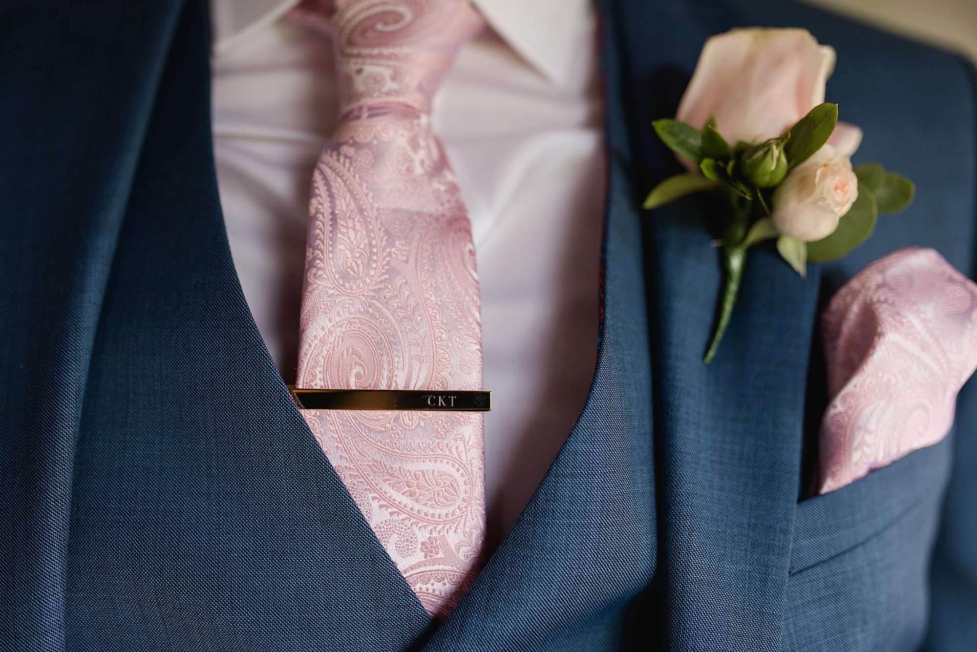 Lillibrooke Manor wedding close up detail of groom's personalised tie pin