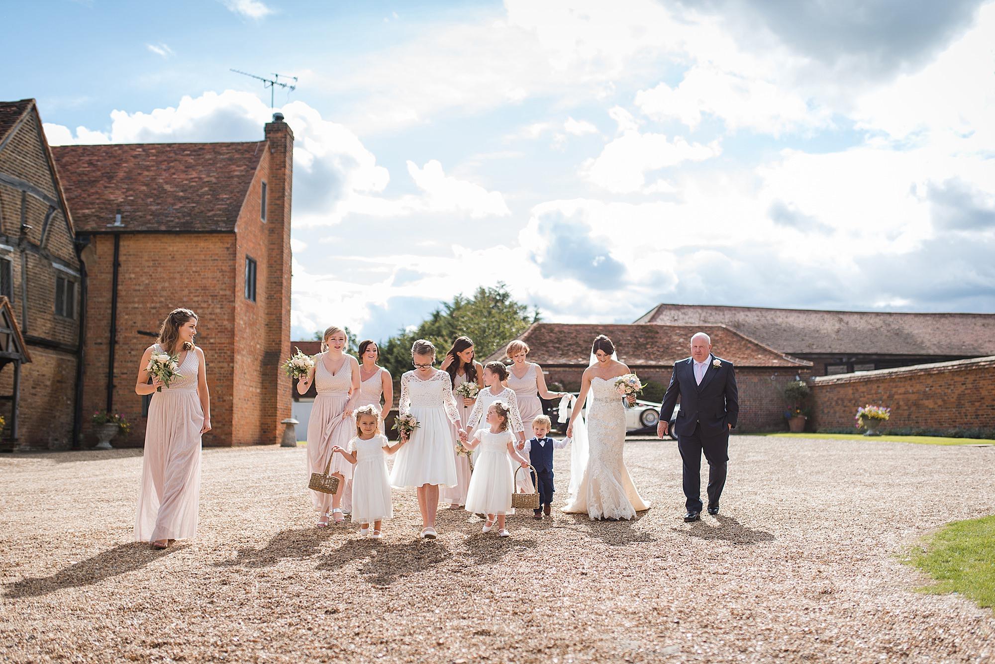 Lillibrooke Manor wedding bridal party walks to ceremony