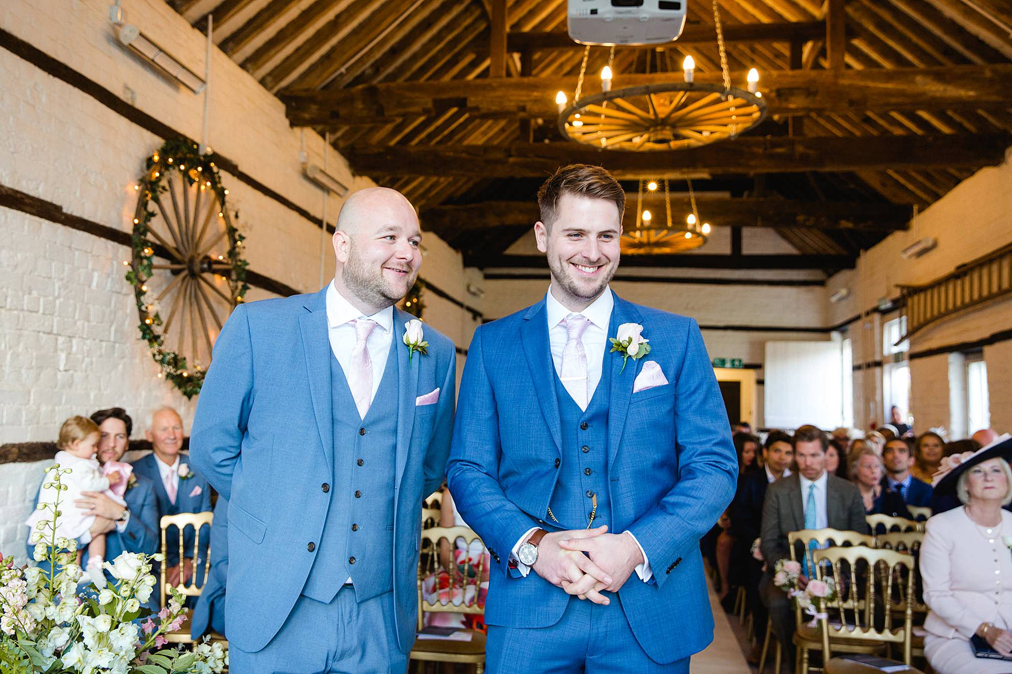 Lillibrooke Manor wedding groom and best man laugh together