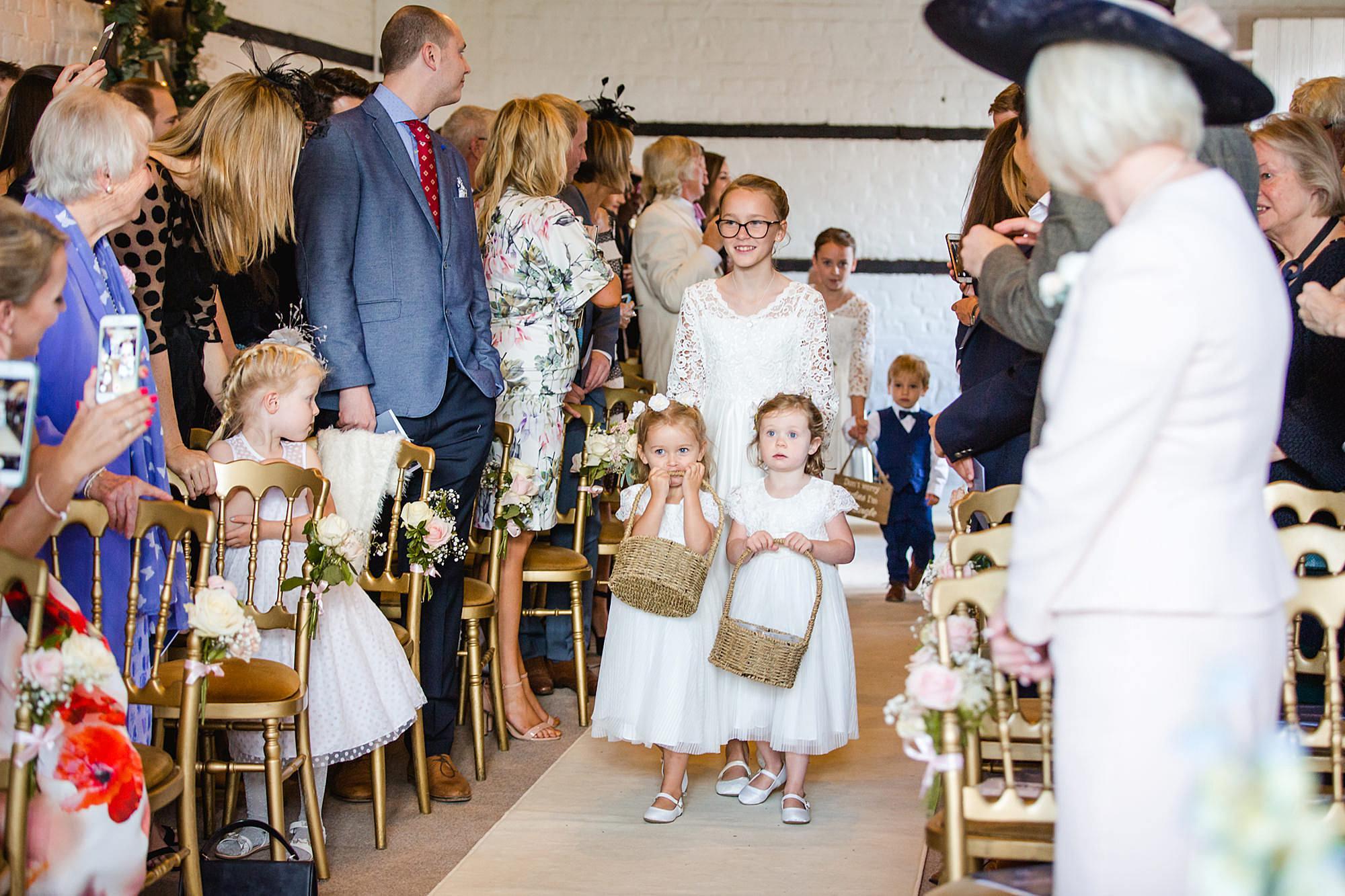 Lillibrooke Manor wedding flower girls walking down the aisle