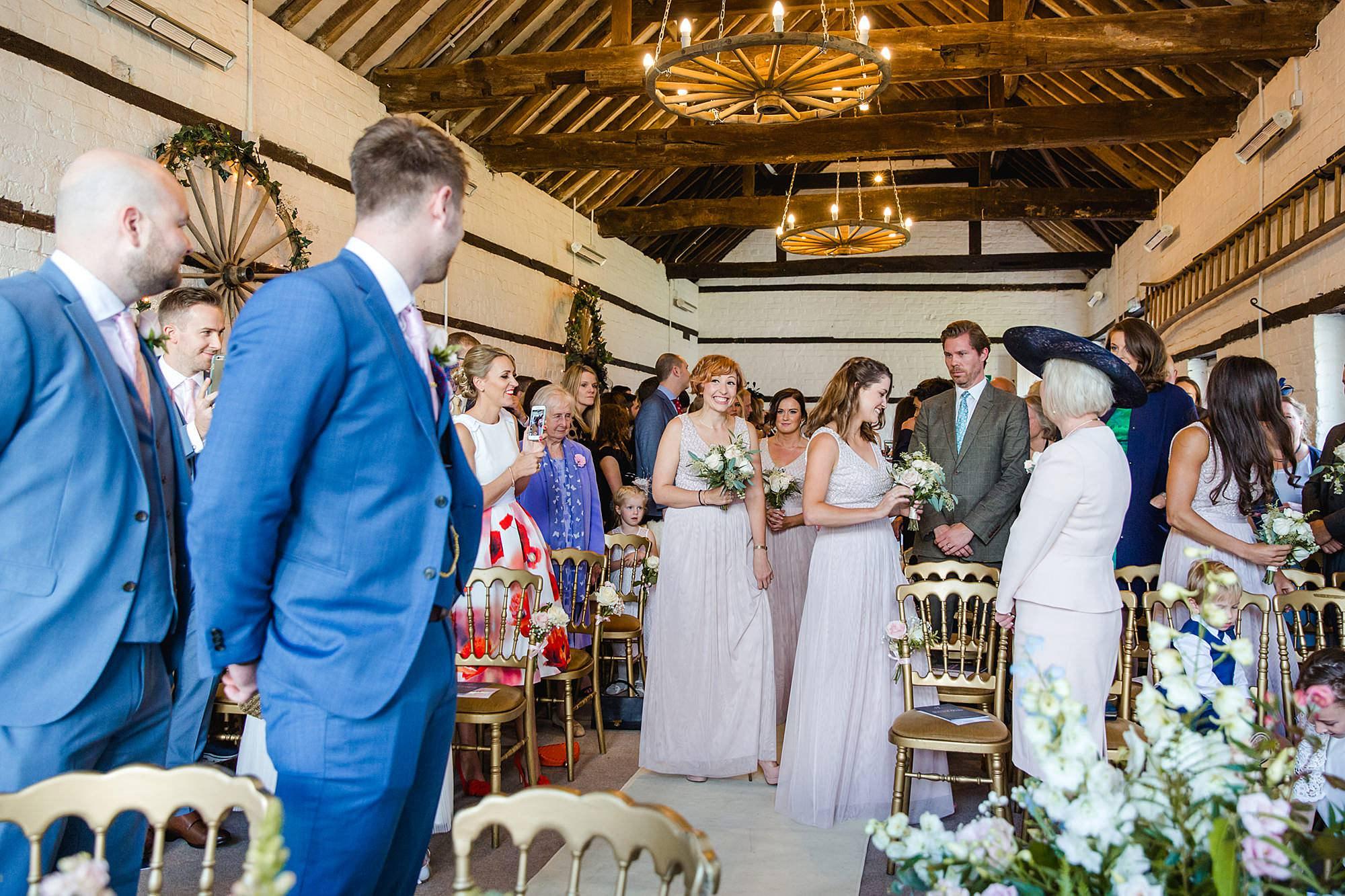 Lillibrooke Manor wedding bridesmaids walking down the aisle