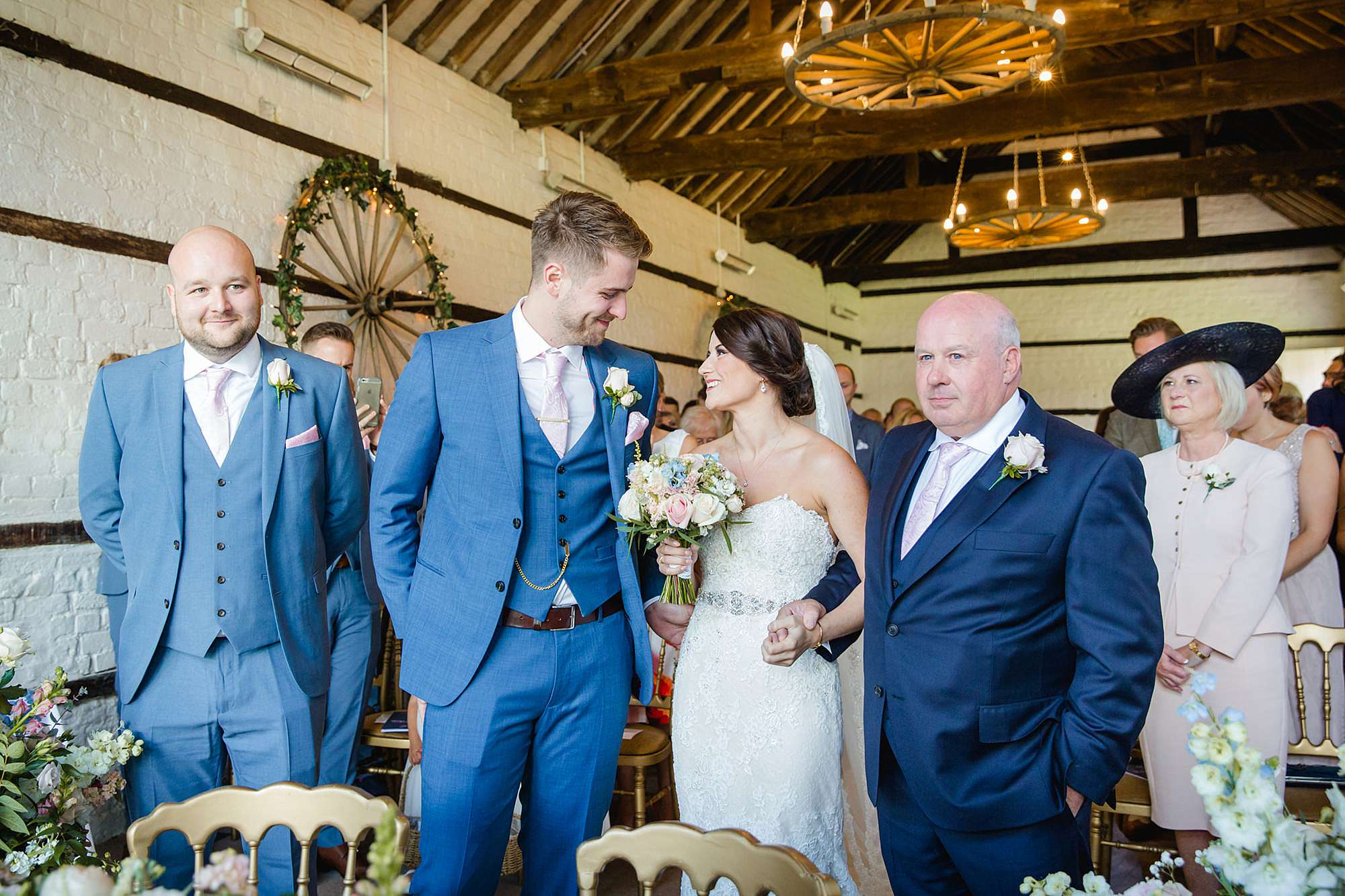 Lillibrooke Manor wedding bride greets groom at end of alter