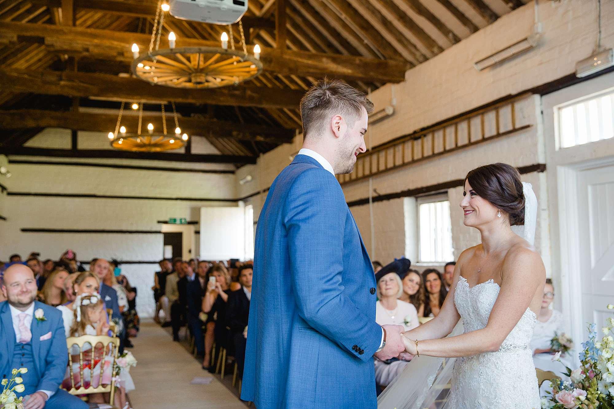 Lillibrooke Manor wedding bride and groom exchange vows