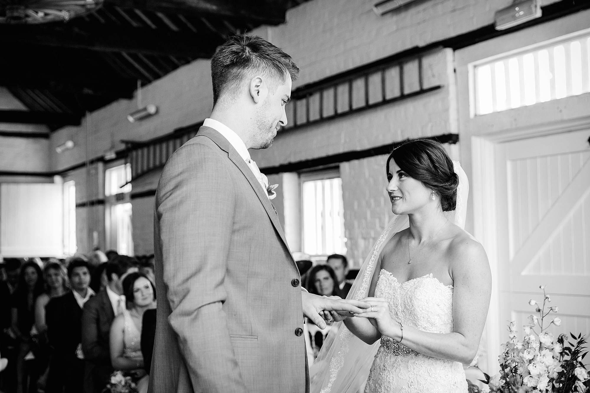 Lillibrooke Manor wedding groom and bride exchange rings