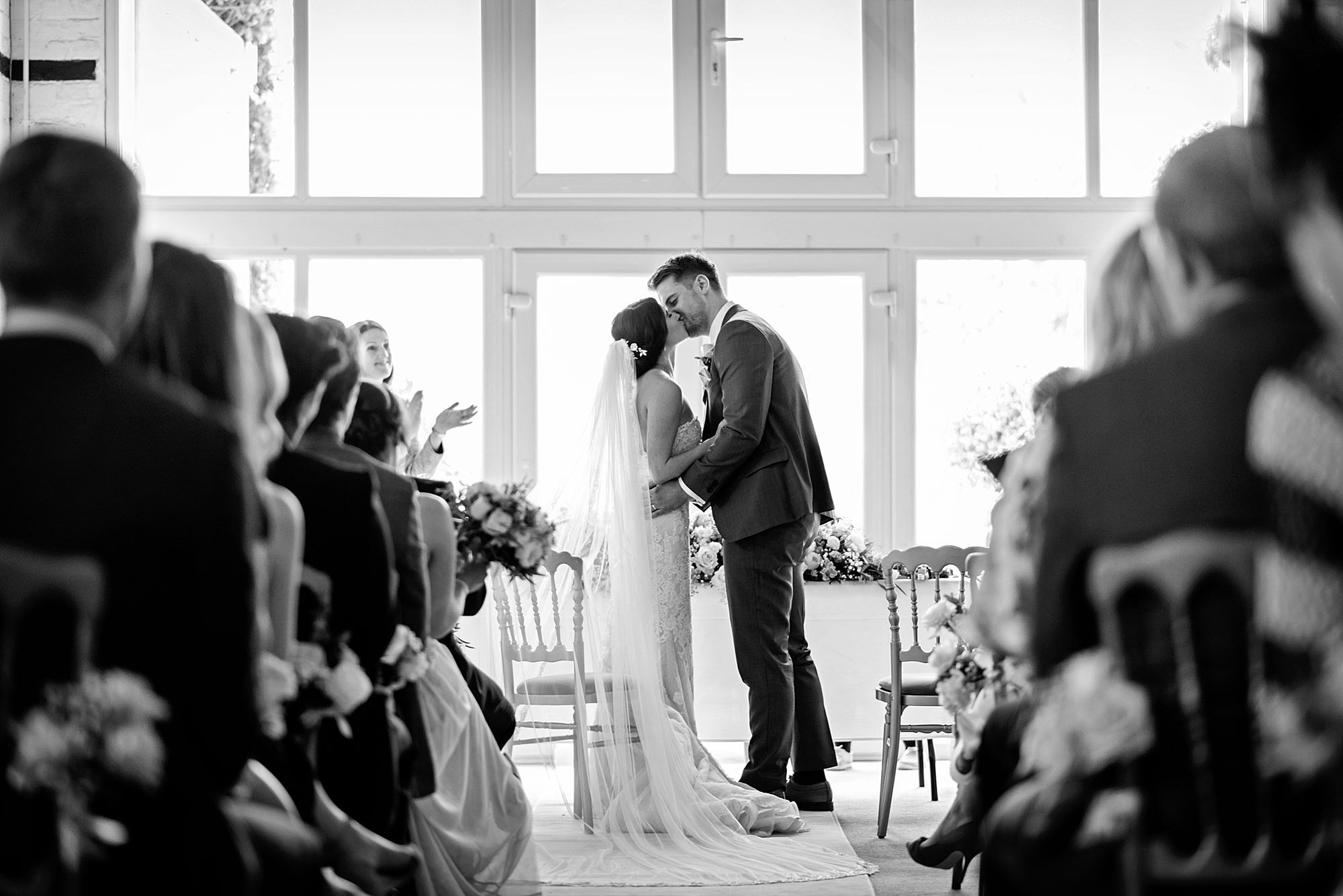 Lillibrooke Manor wedding bride and groom first kiss