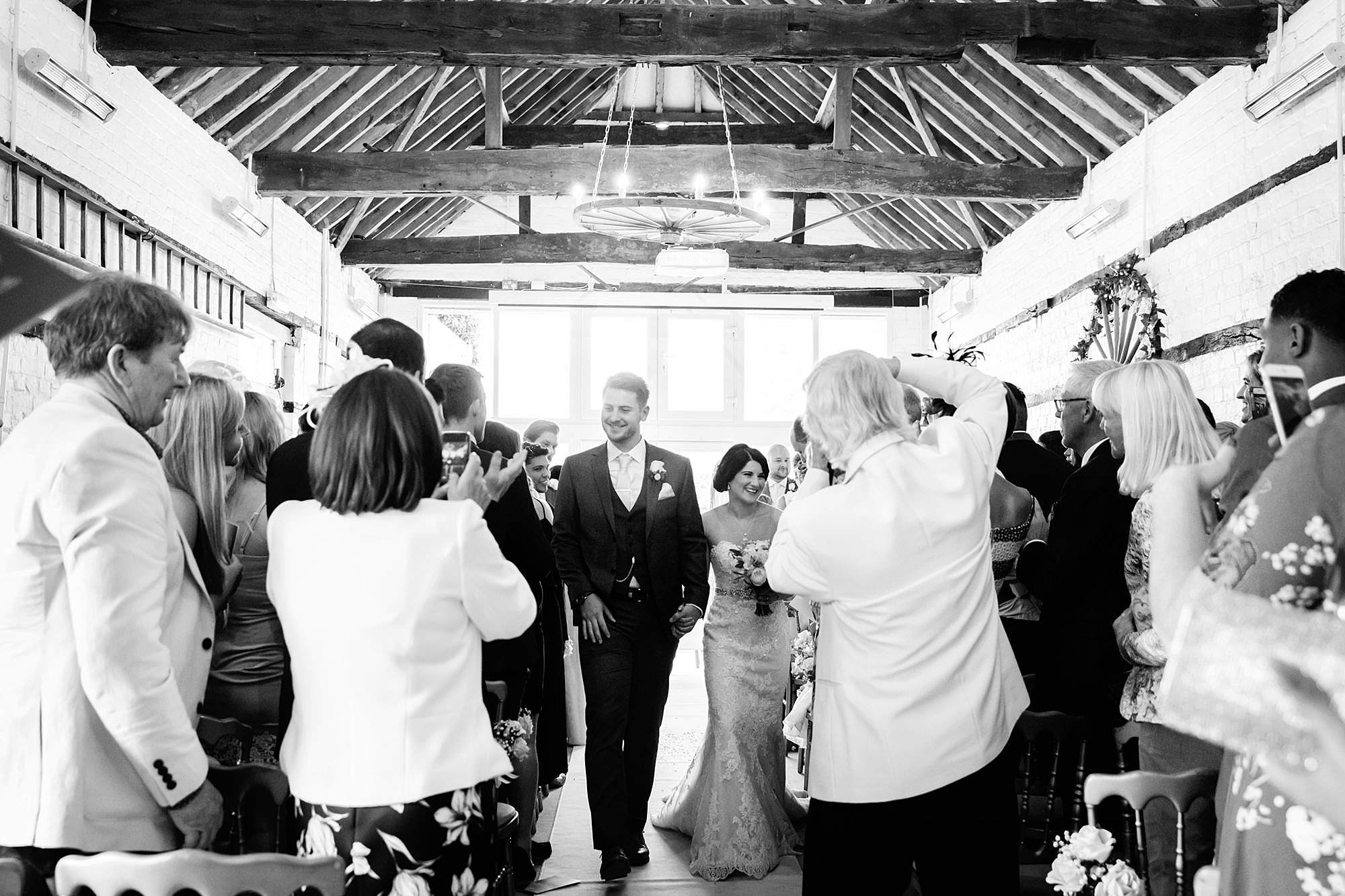 Lillibrooke Manor wedding bride and groom walk back down the aisle