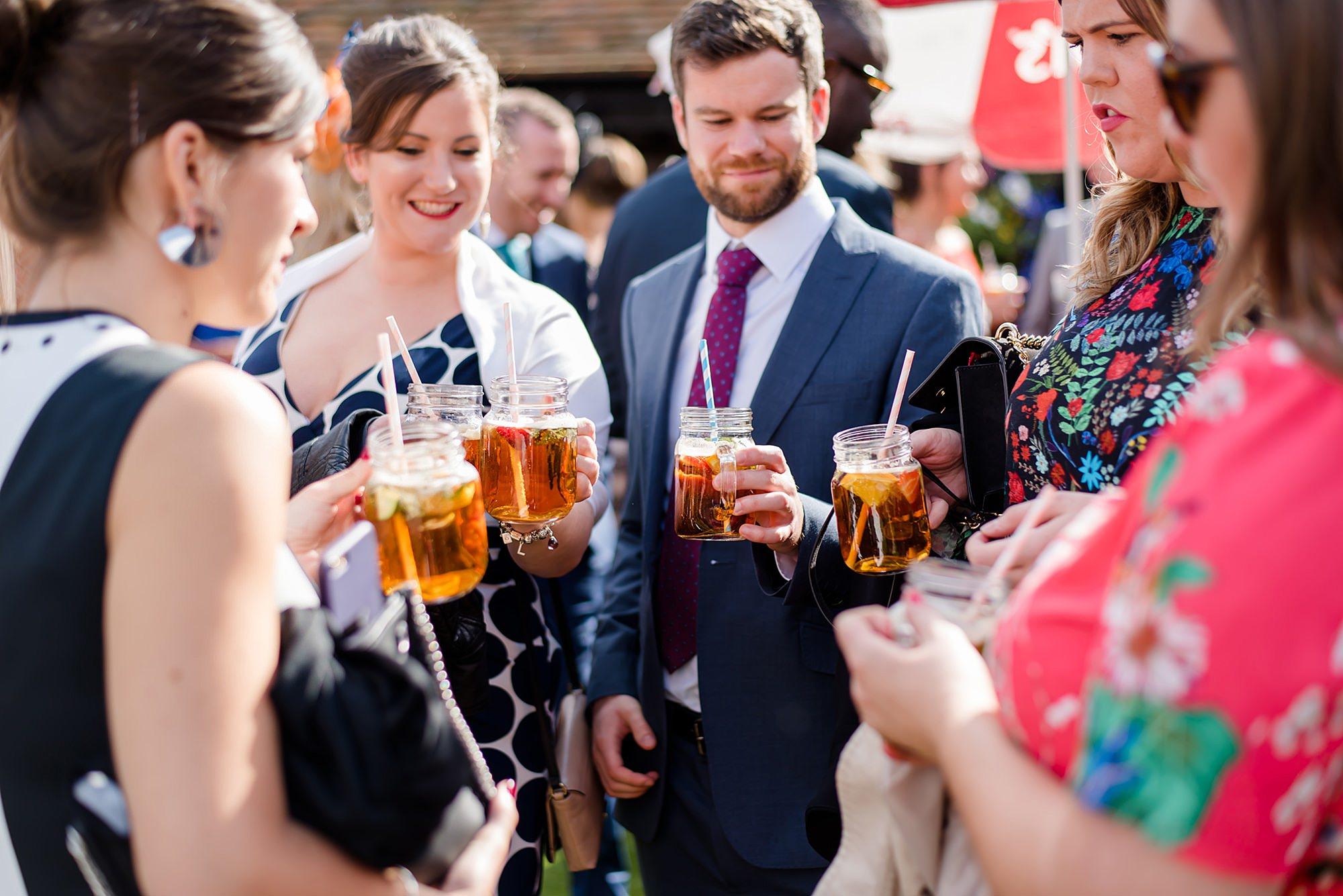 Lillibrooke Manor wedding guests enjoy pimms