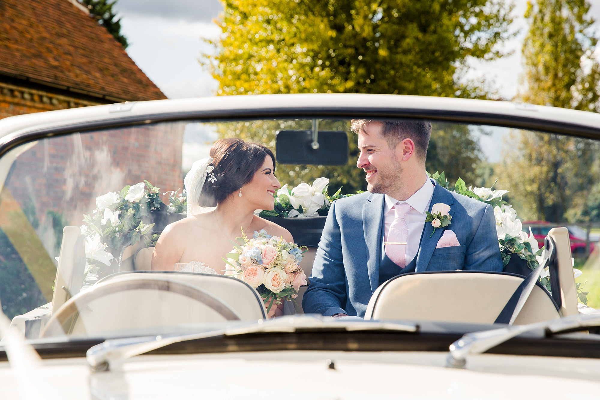 Lillibrooke Manor wedding bride and groom in wedding car