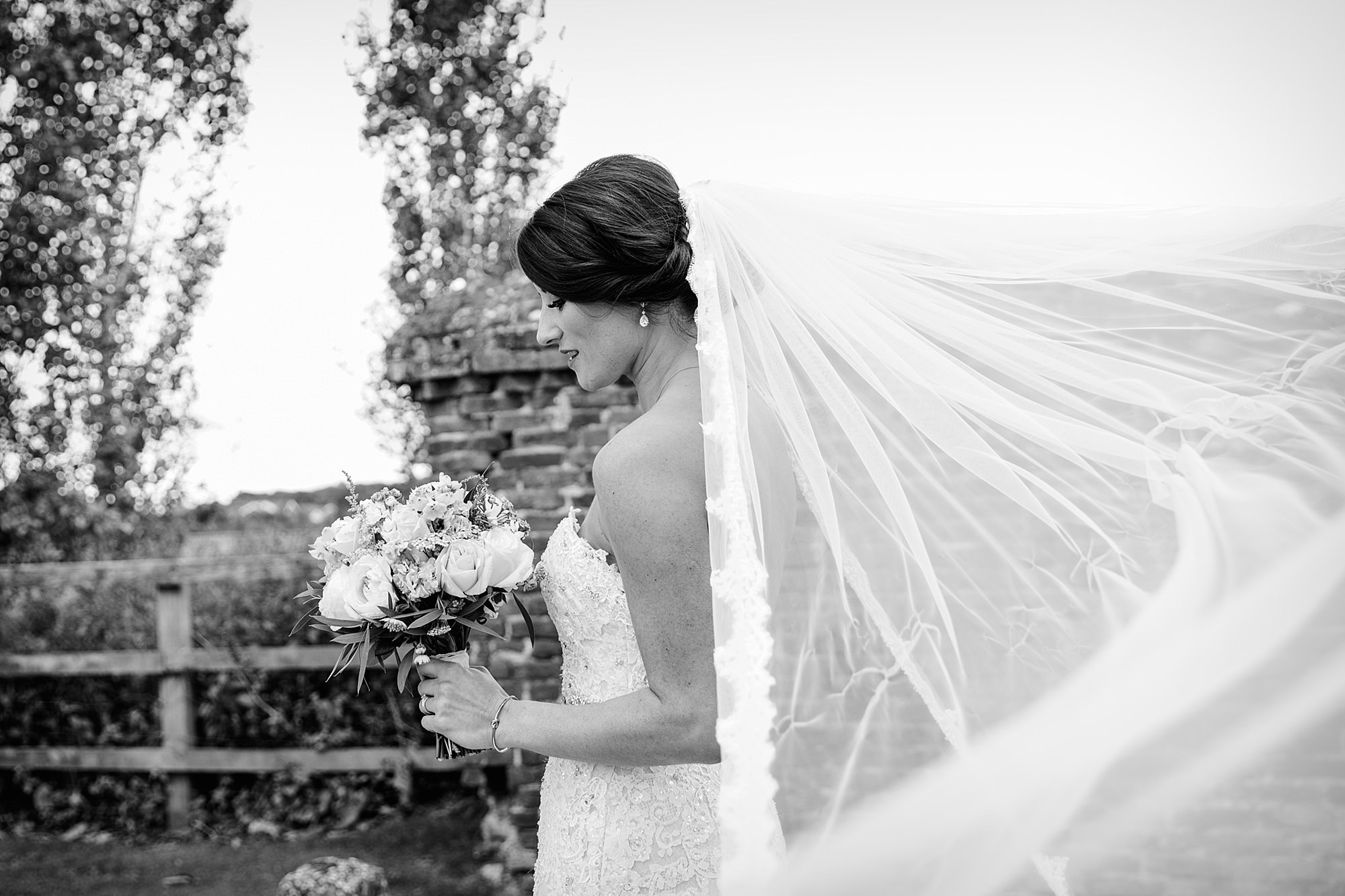Lillibrooke Manor wedding portrait of bride with her veil in the wind