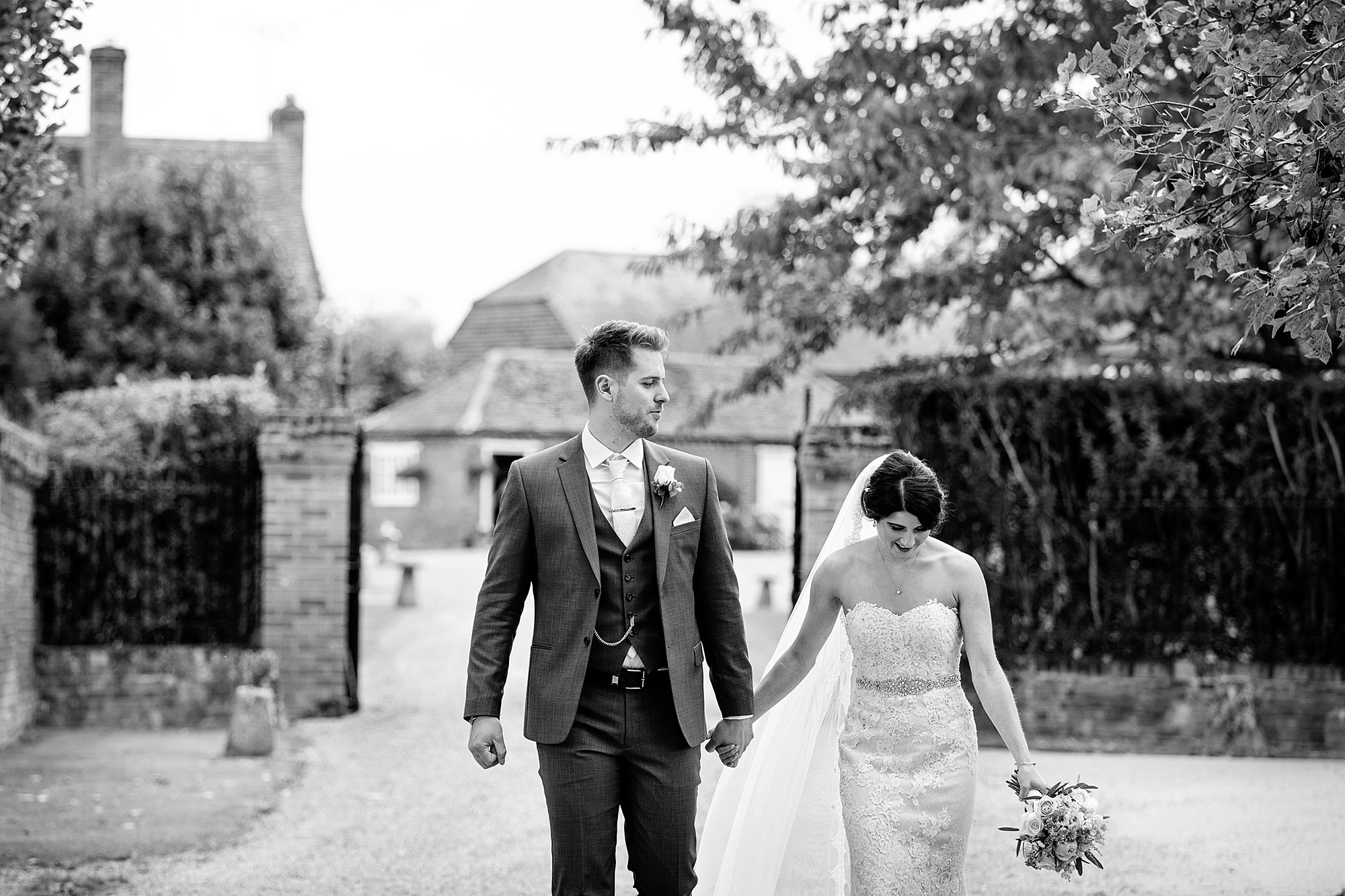 Lillibrooke Manor wedding bride and groom walk and laugh