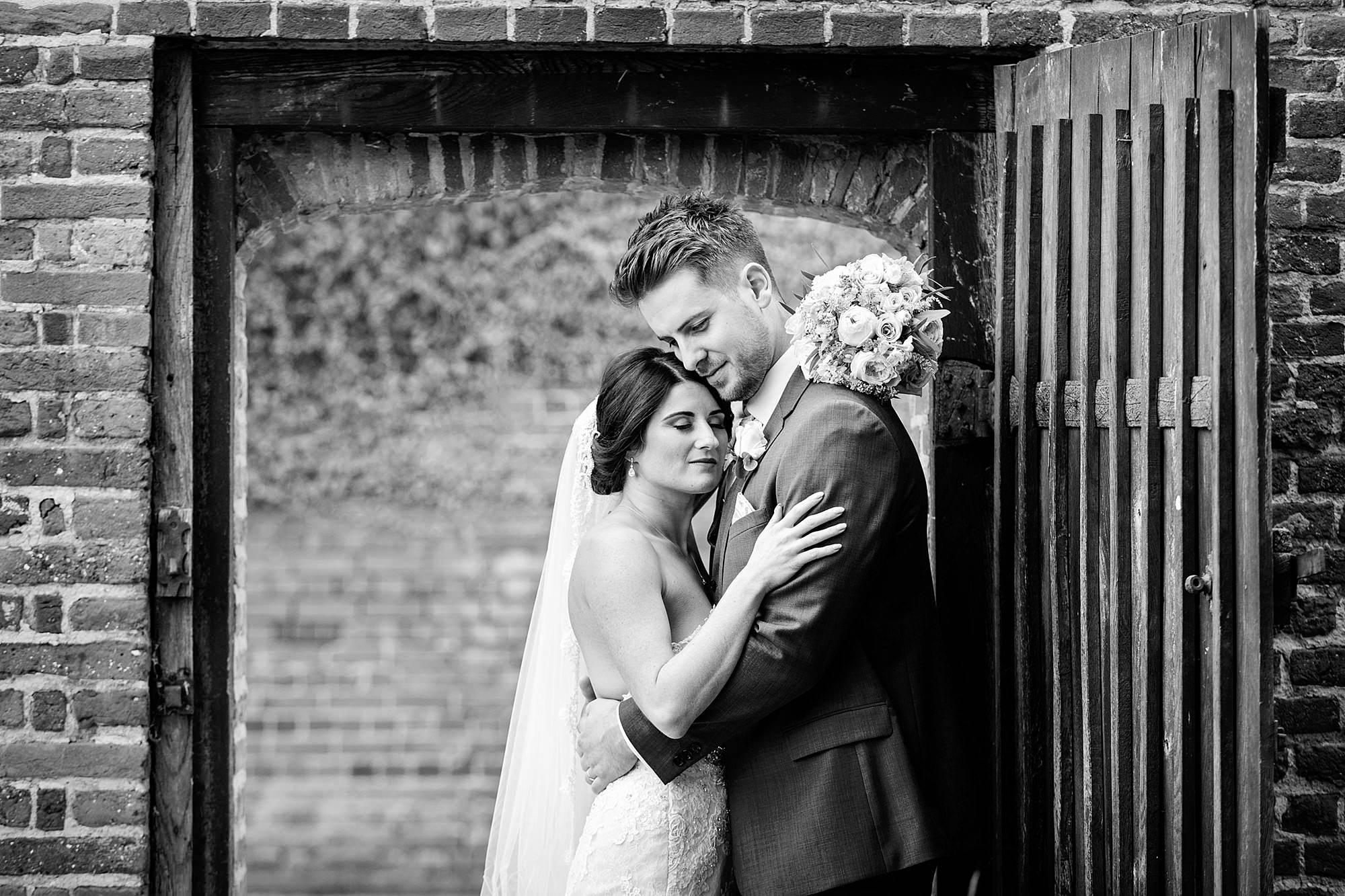 Lillibrooke Manor wedding bride and groom hug in doorway
