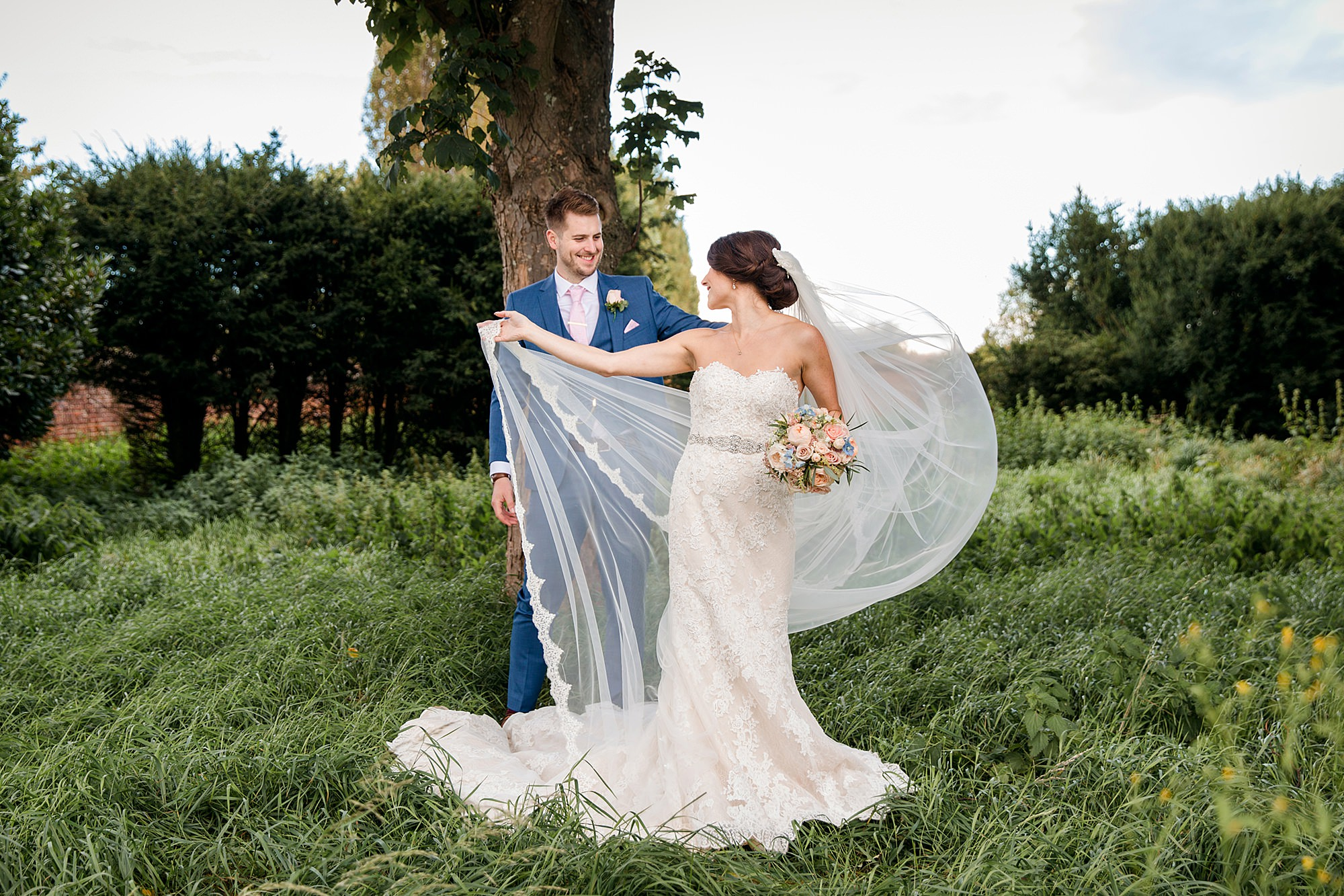 Lillibrooke Manor wedding bride's veil blows in the wind