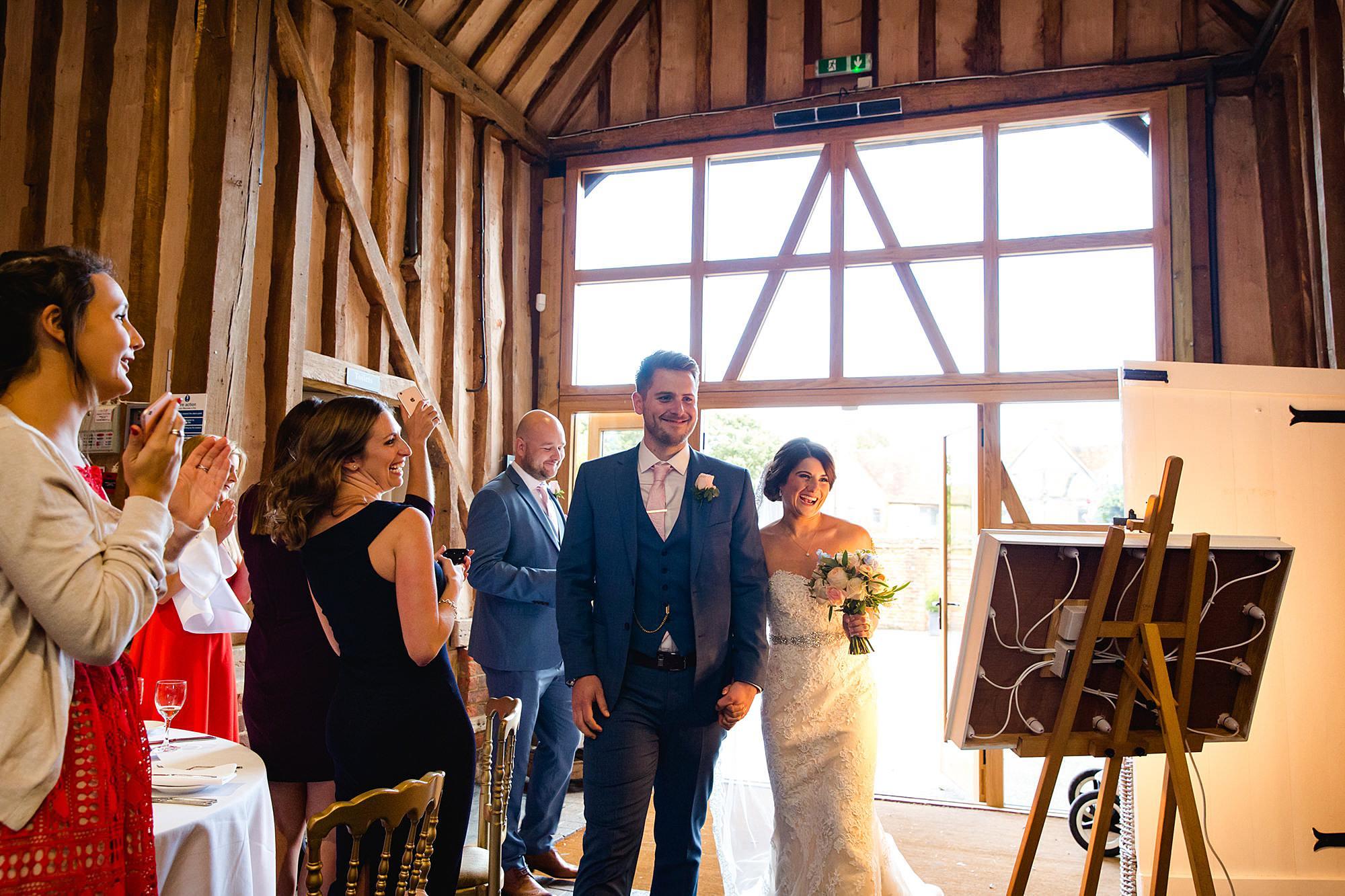 Lillibrooke Manor wedding bride and groom enter wedding breakfast
