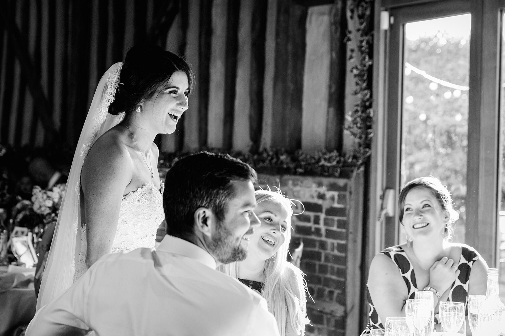 Lillibrooke Manor wedding bride laughs with guests