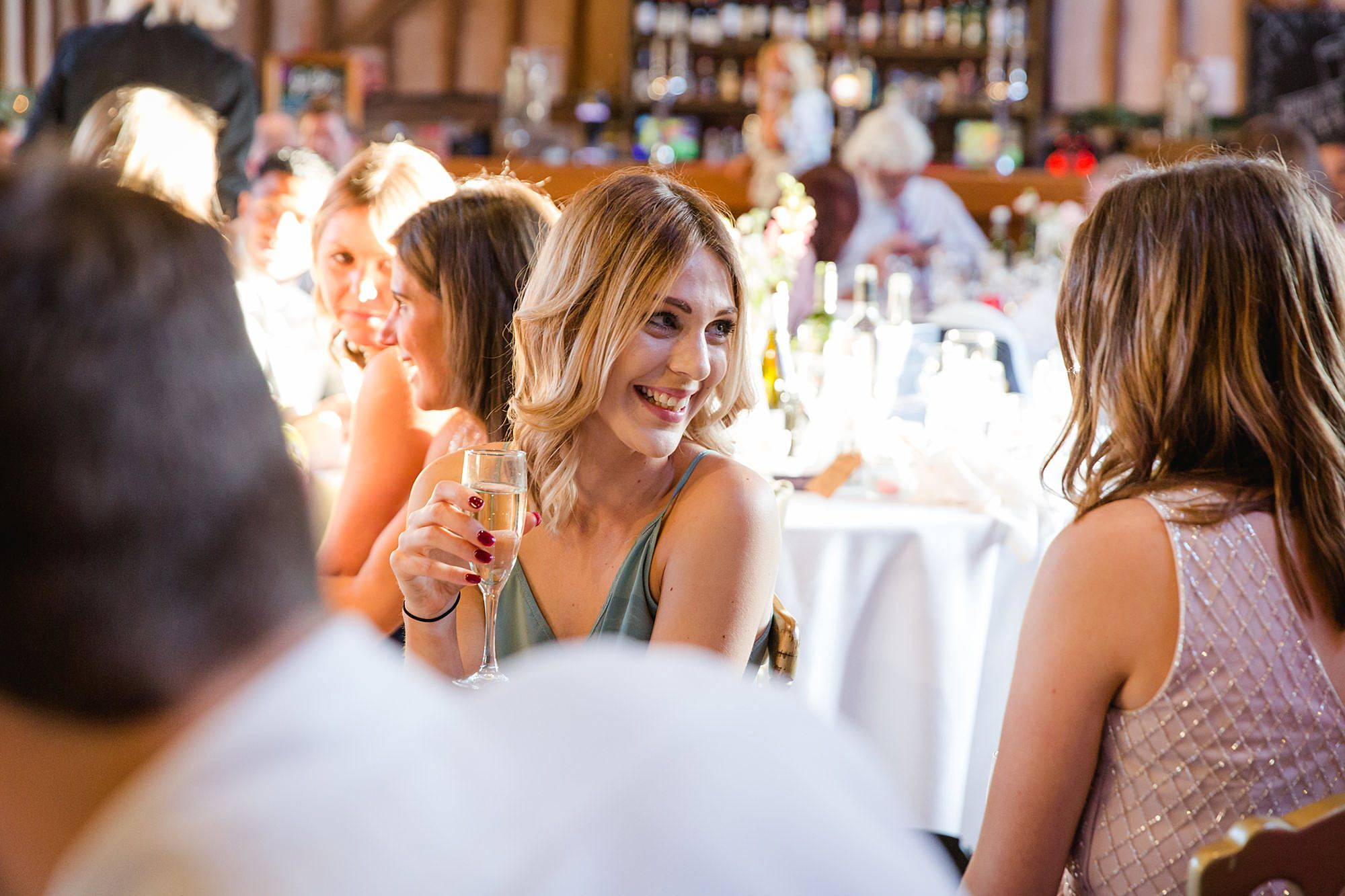 Lillibrooke Manor wedding guests laugh over dinner