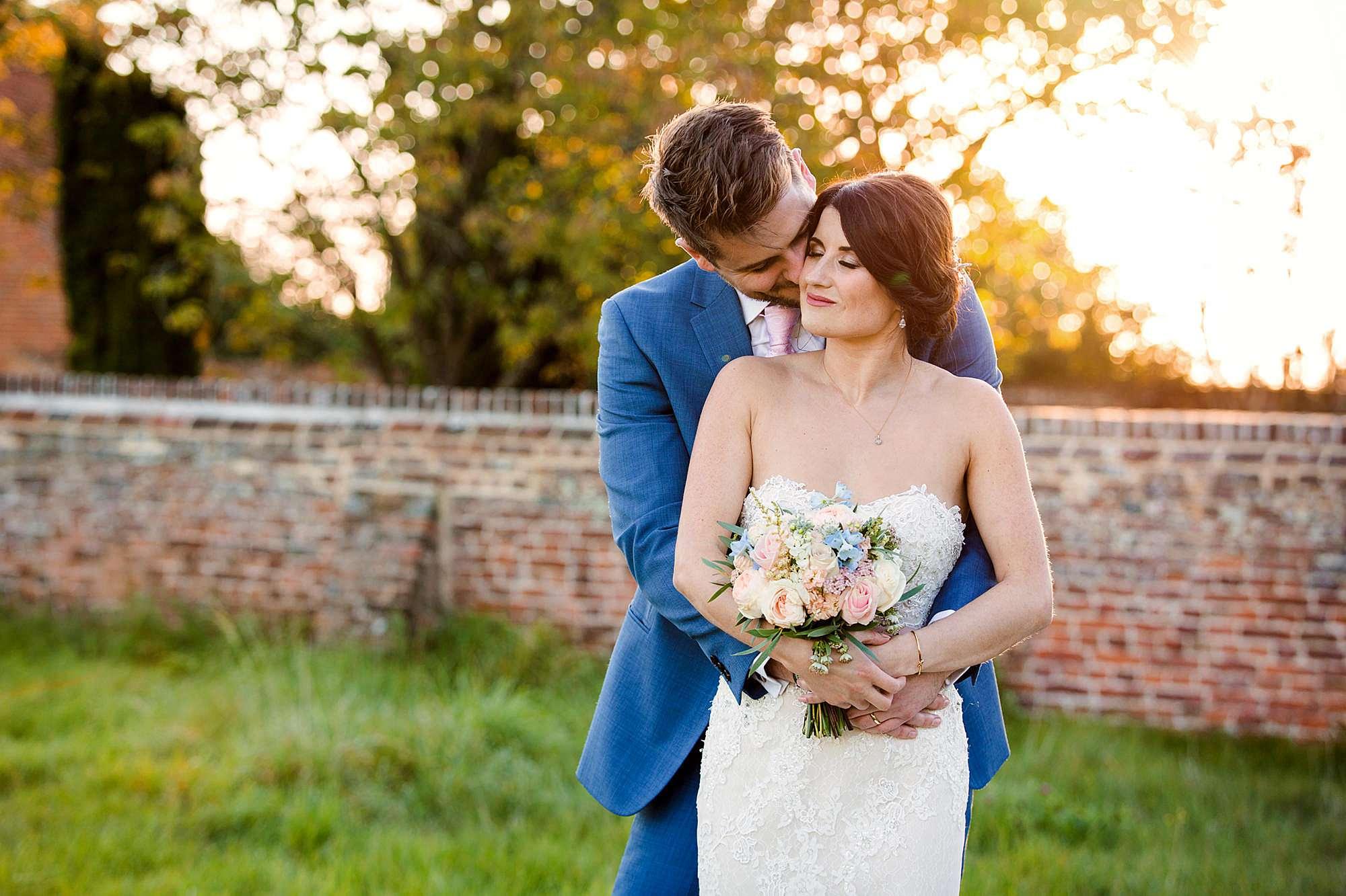 Lillibrooke Manor wedding groom kisses his bride on the cheek