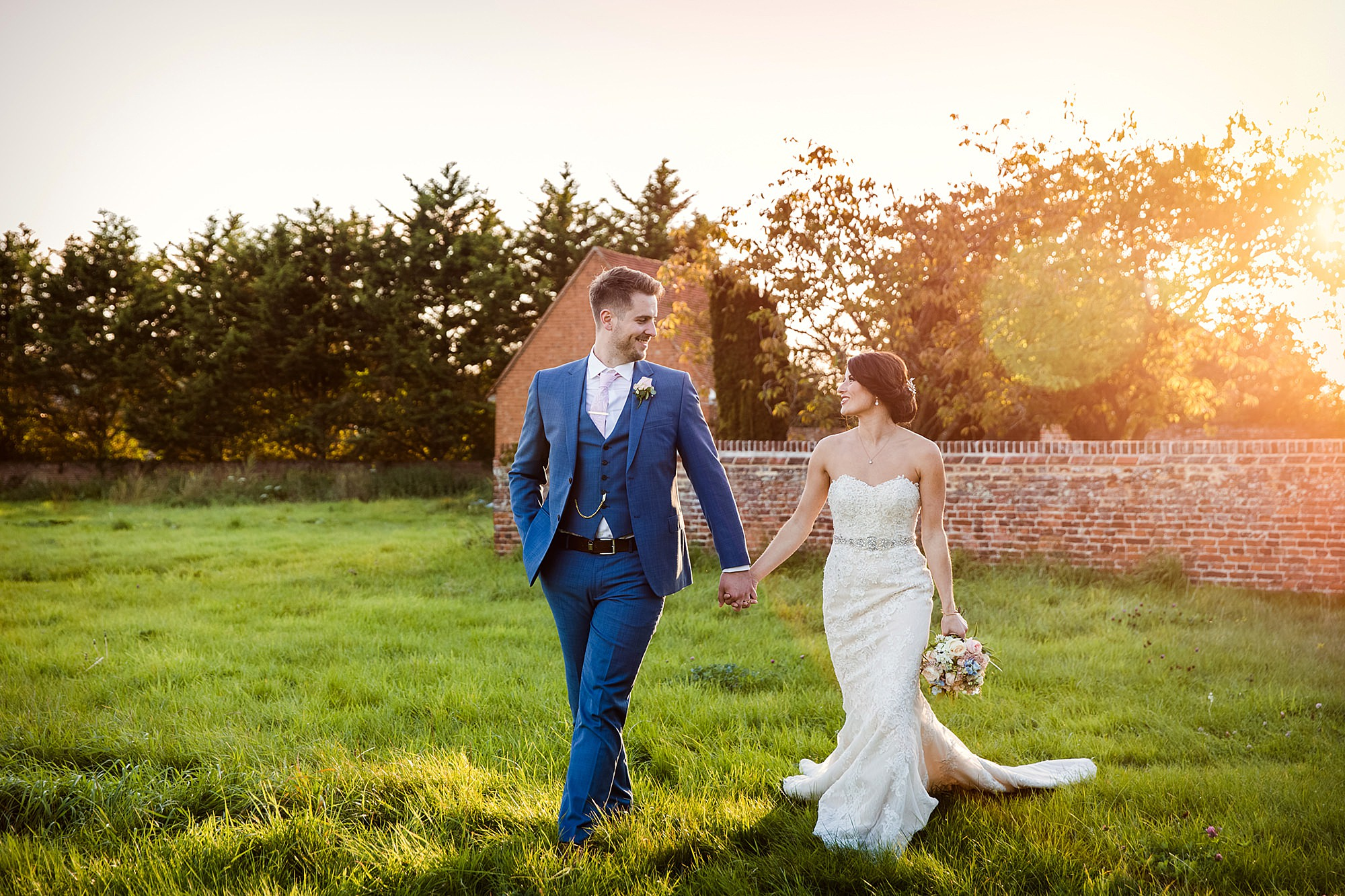 Lillibrooke Manor wedding bride and groom walking at sunset