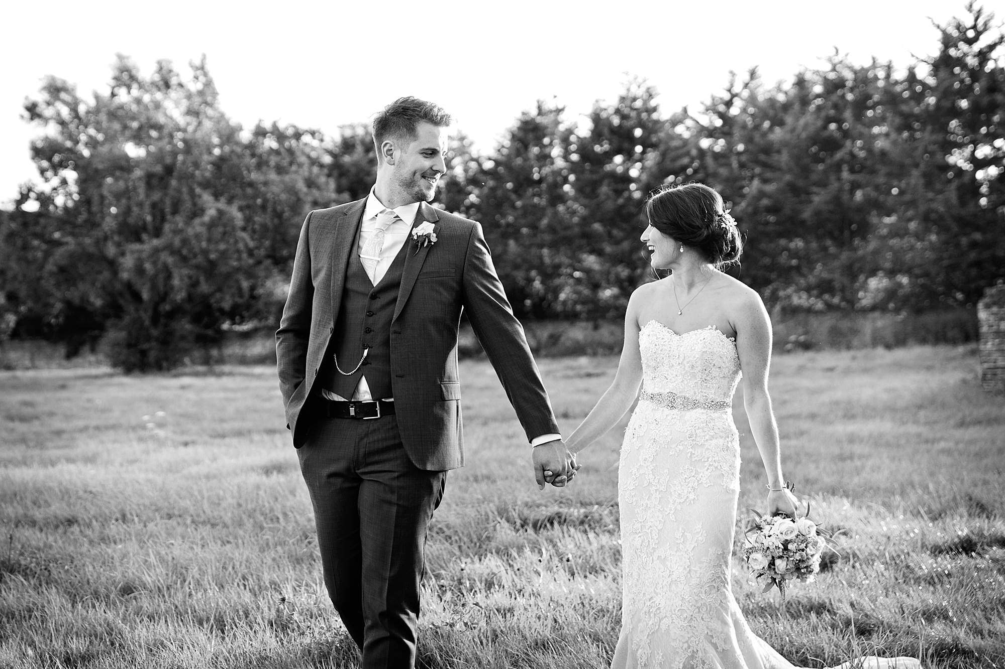 Lillibrooke Manor wedding bride and groom walk and hold hands